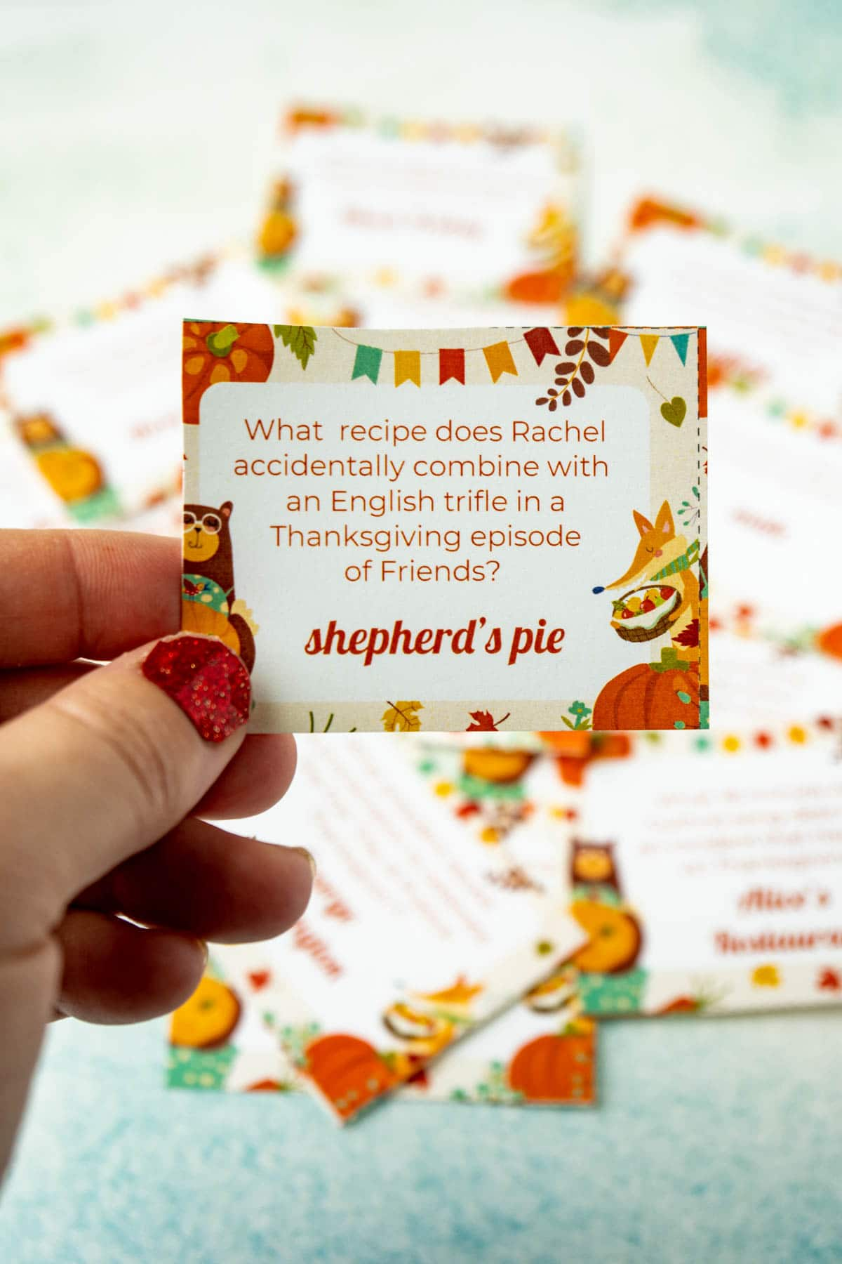 Hand holding a Thanksgiving trivia question card