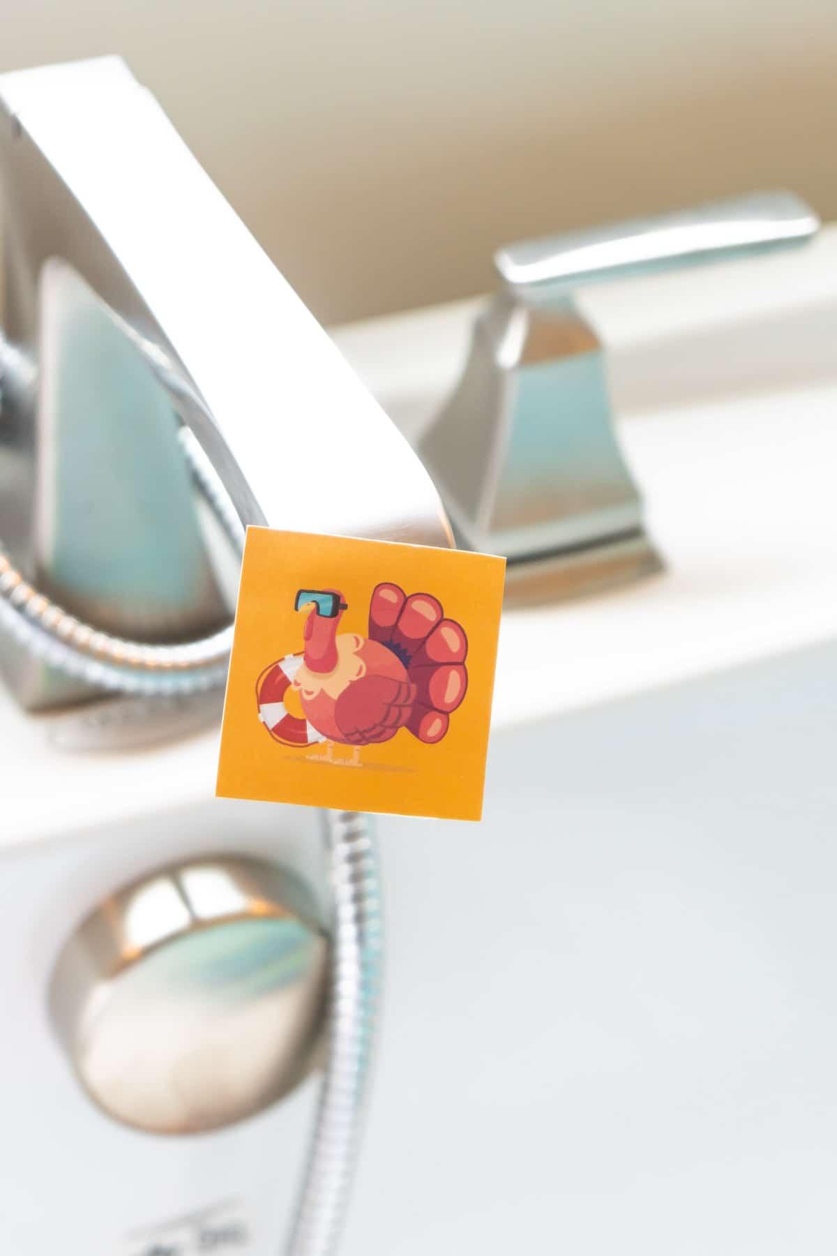 Turkey cutout on a bathtub faucet