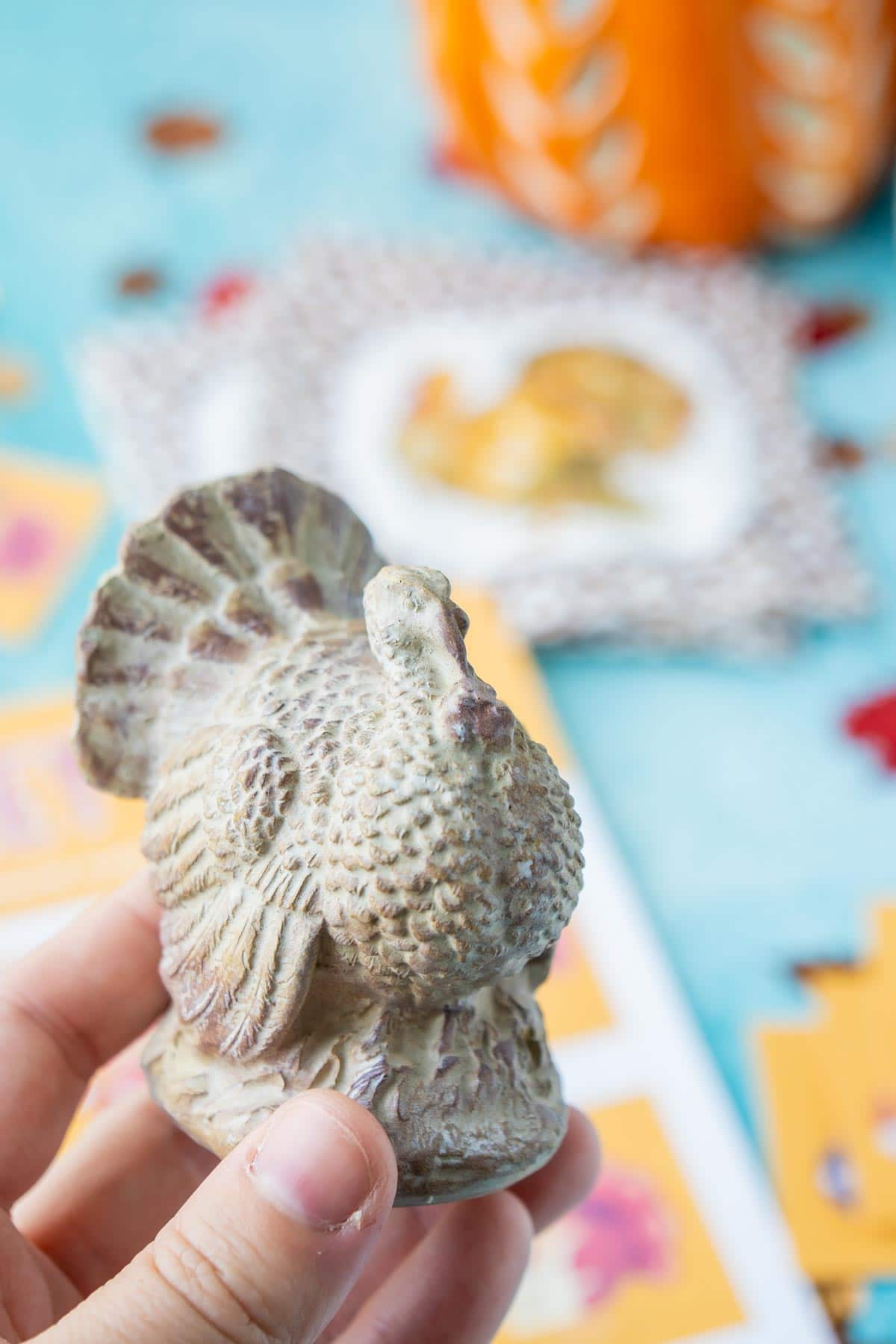 Ceramic turkey being held in a woman's hand