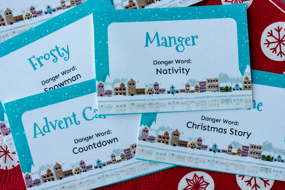 Horizontal photos of a pile of Christmas danger words cards