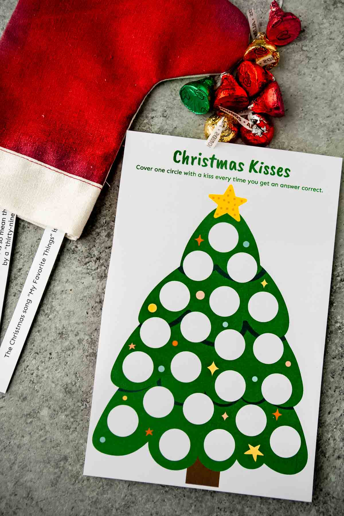 Printed out Christmas trivia game card with questions nearby