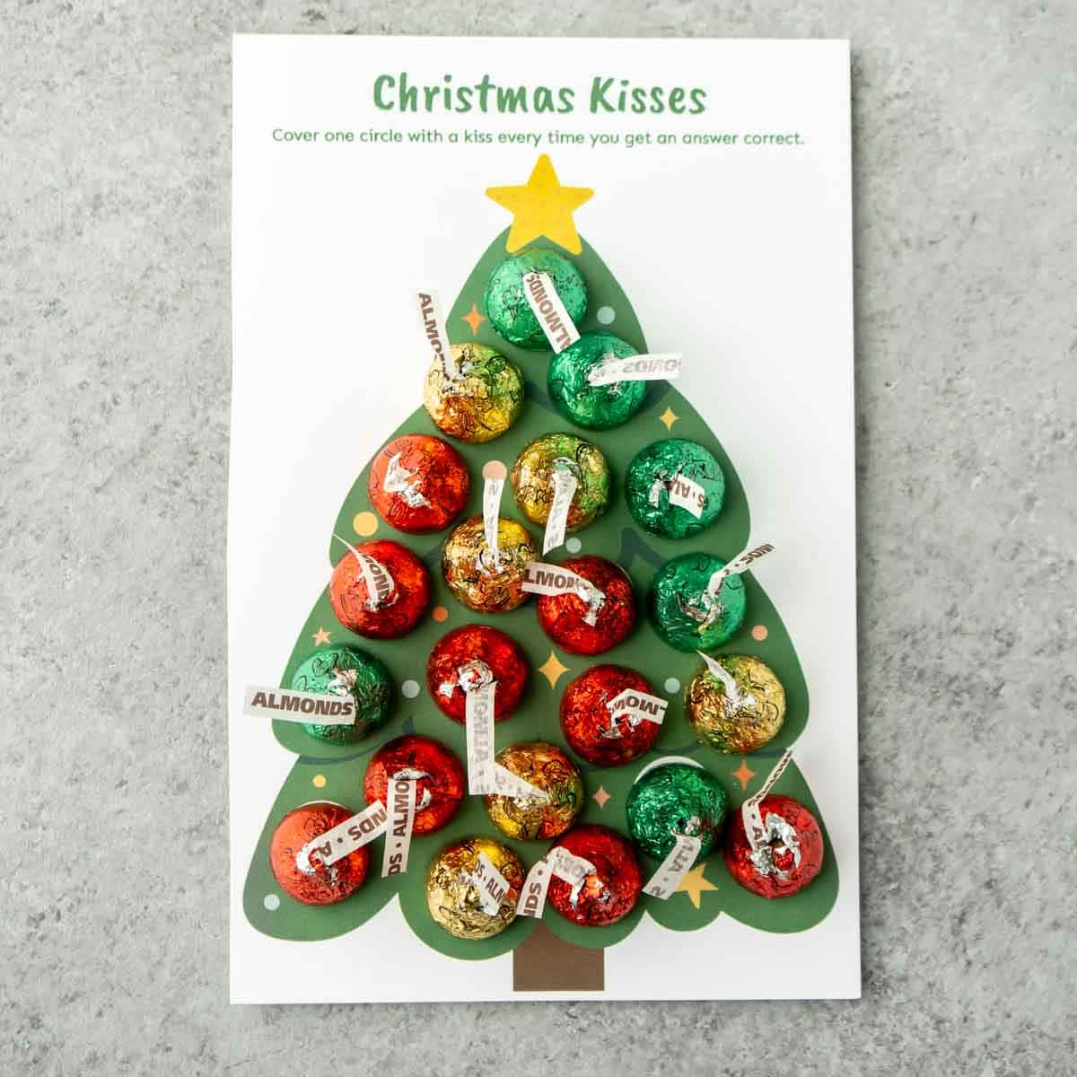 Christmas kisses Christmas trivia game with Hershey's kisses on top