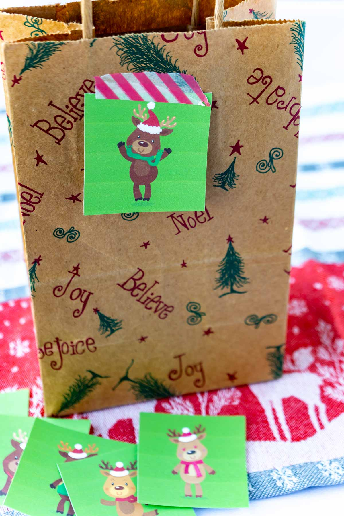 Brown paper bag with a reindeer hunt card on it
