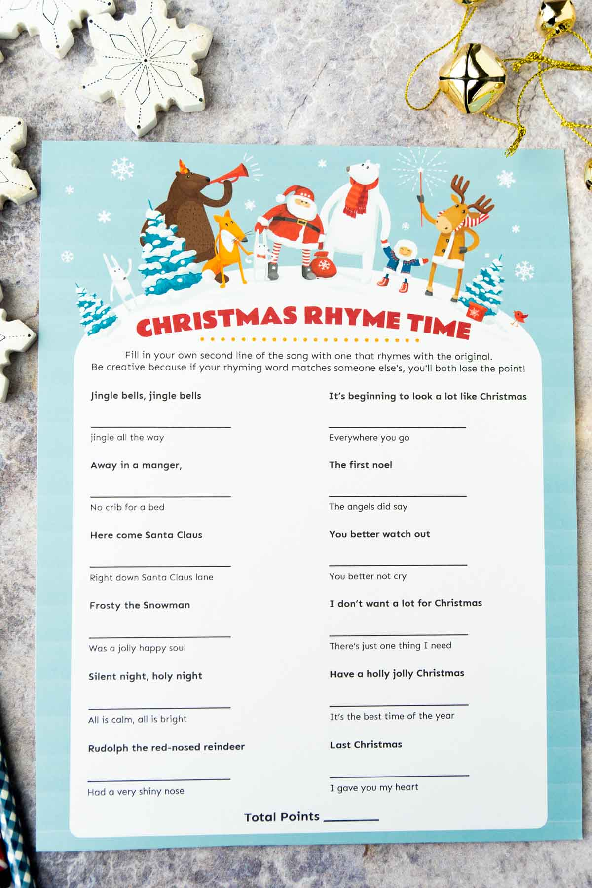 Christmas rhyme game printable with snowflakes in the background