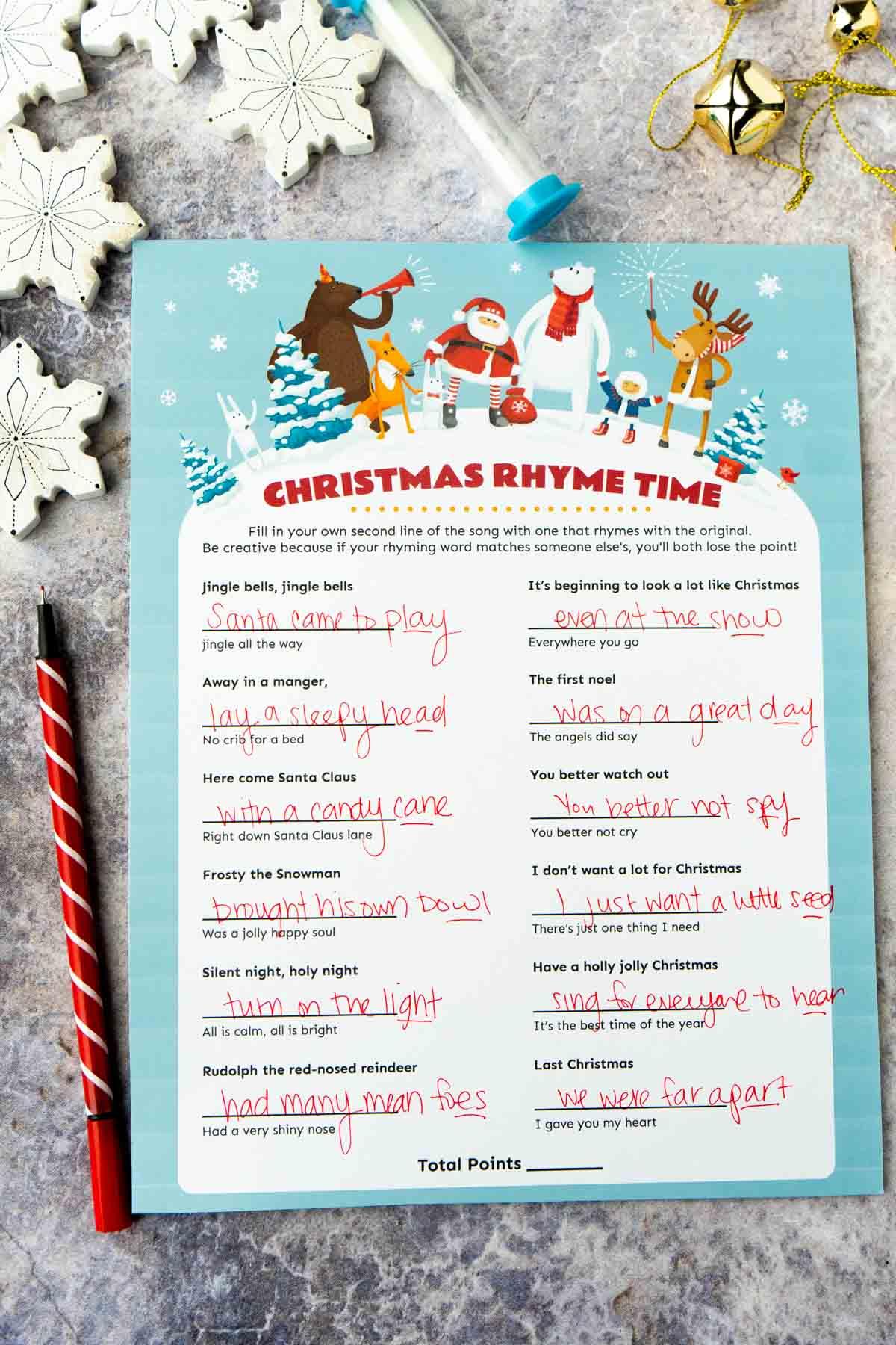 Christmas rhyme game with lyrics written on it