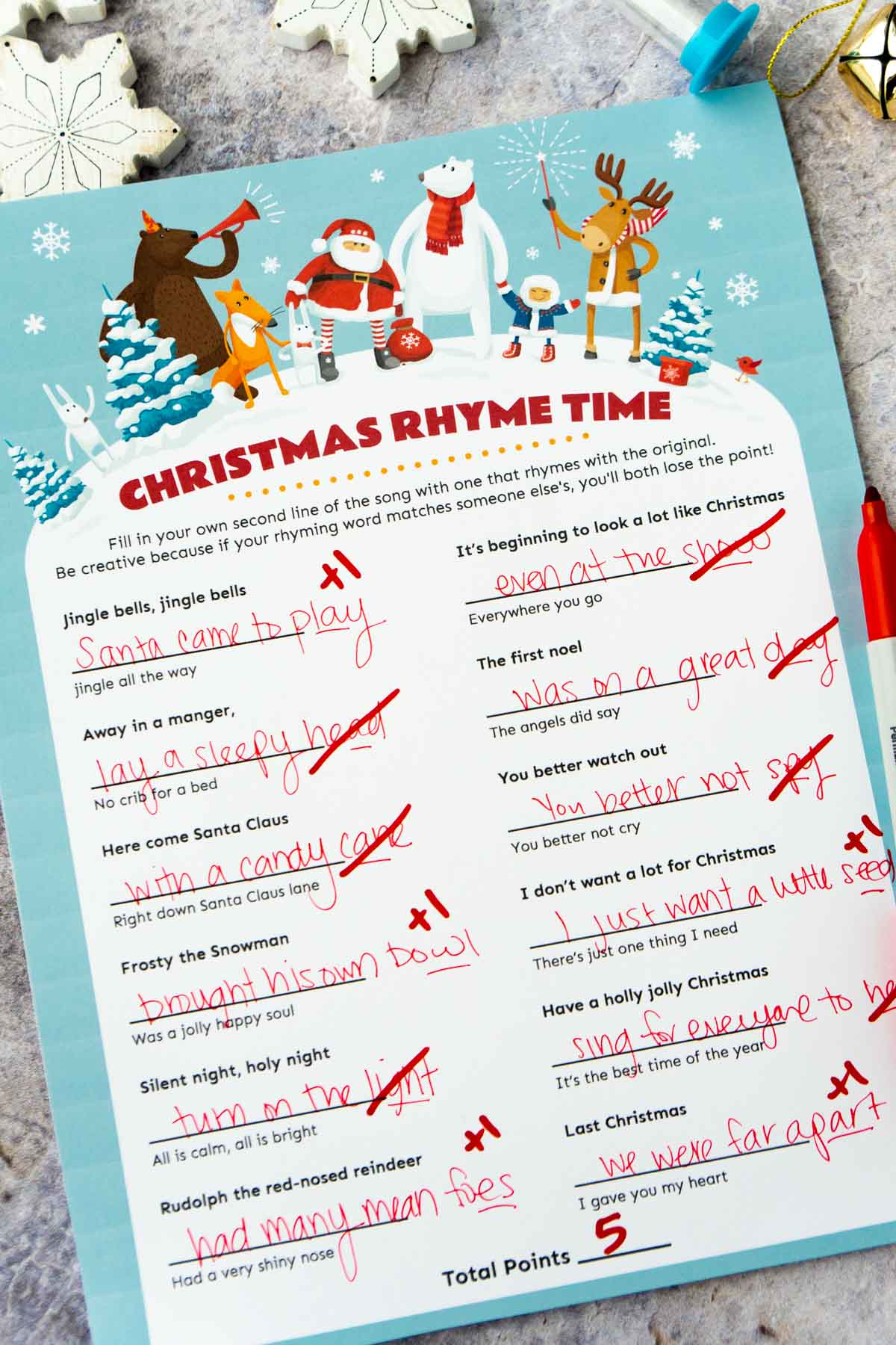 Christmas rhyme game with questions crossed off