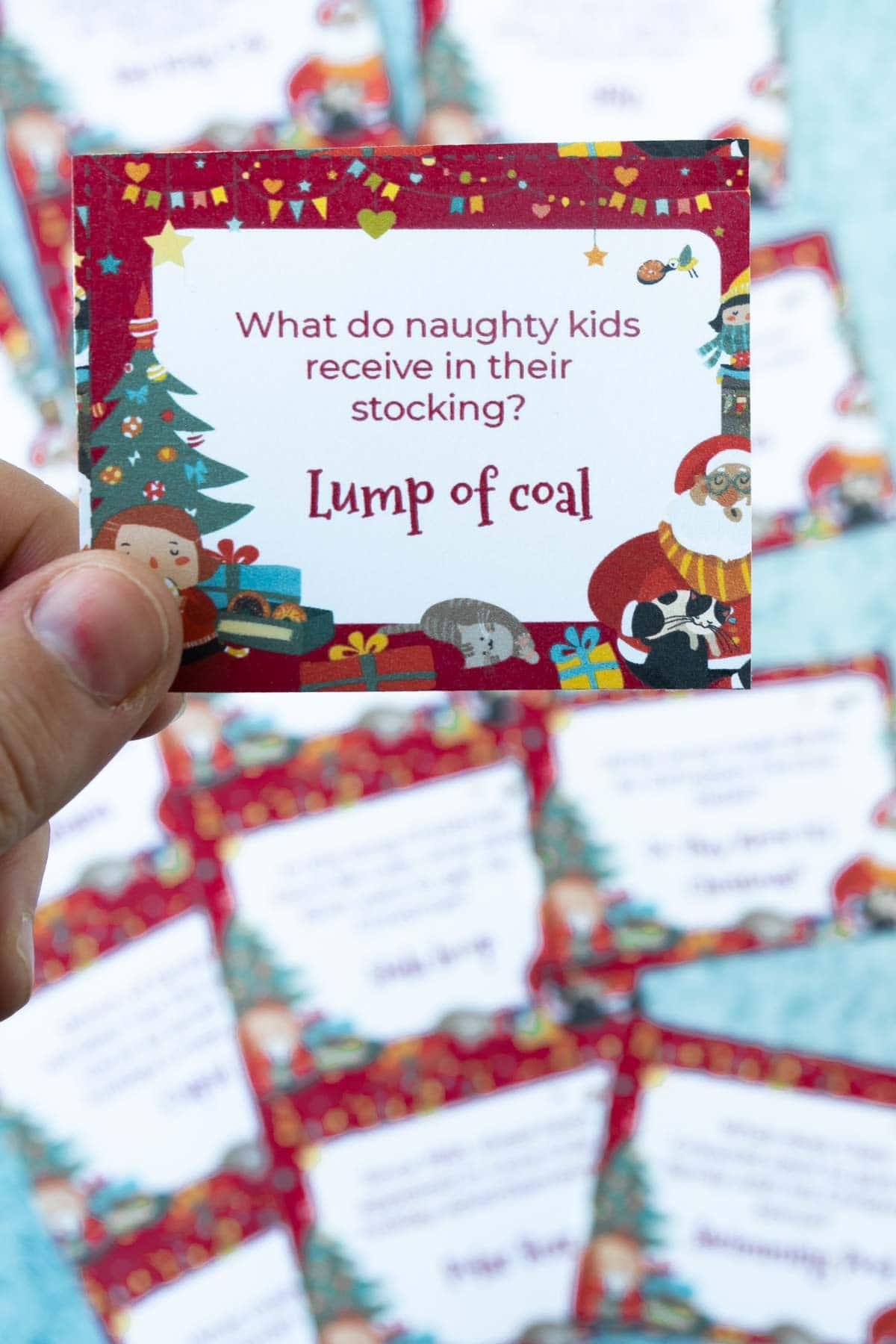 Hand holding a Christmas trivia card