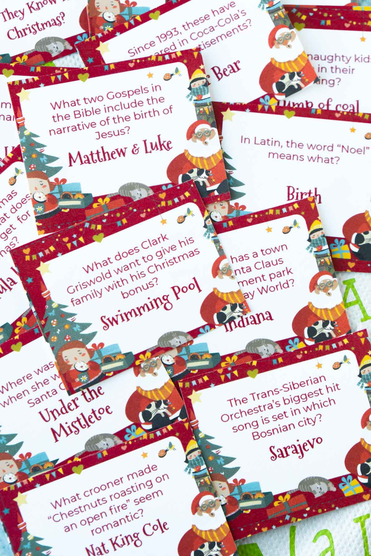 Christmas trivia questions on cards in a pile
