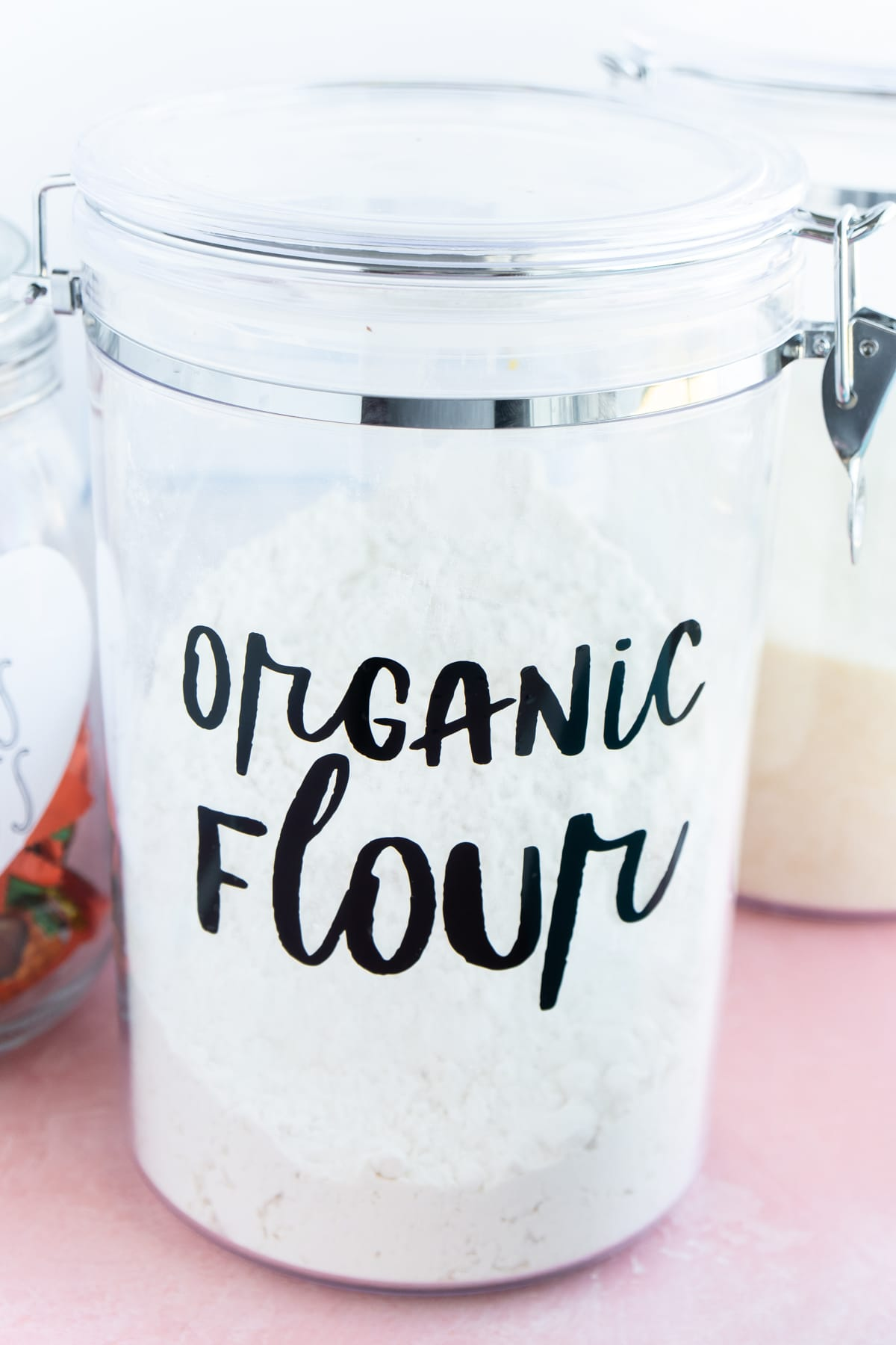 plastic canister with organic flour in vinyl