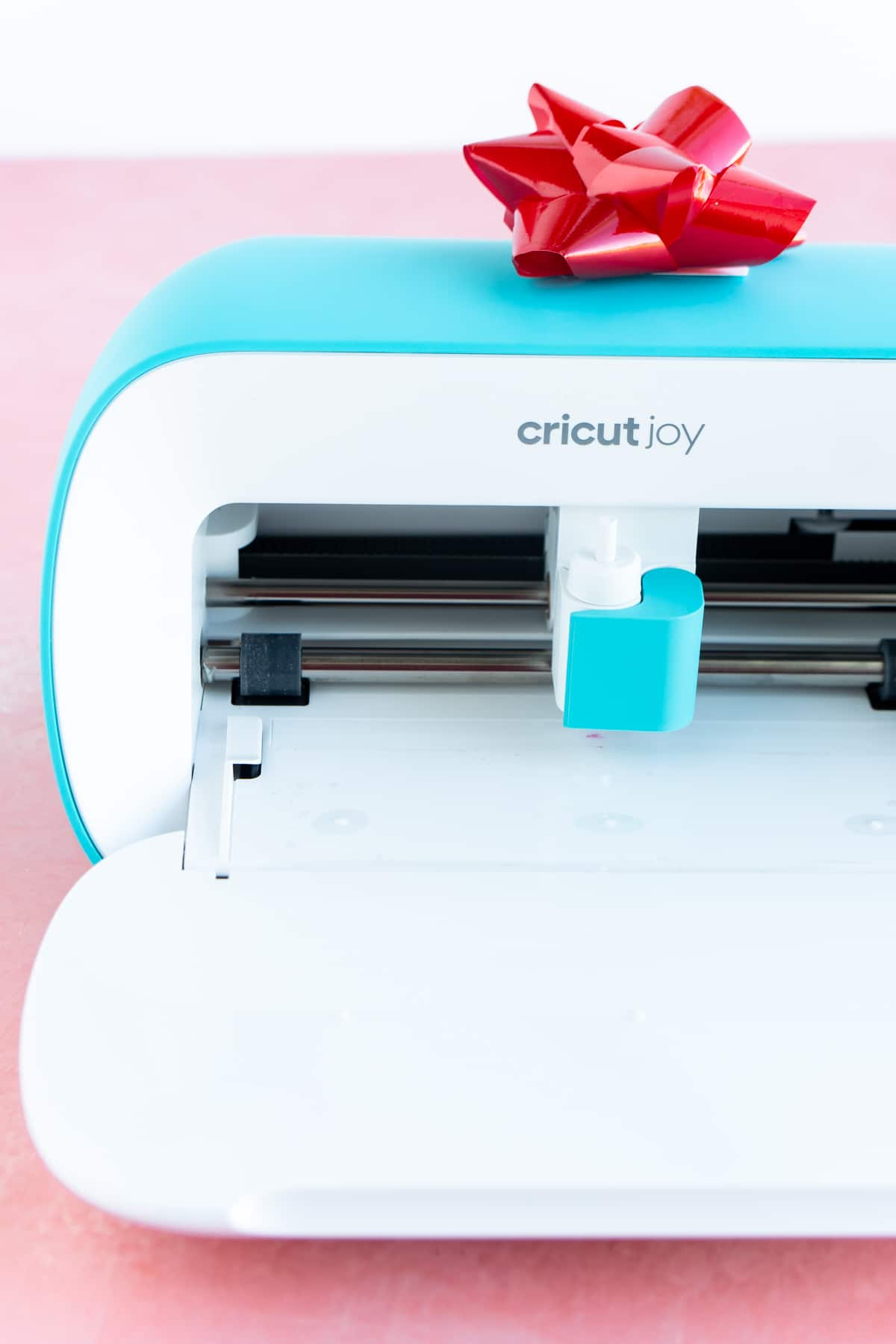 Cricut Joy with a red bow on top