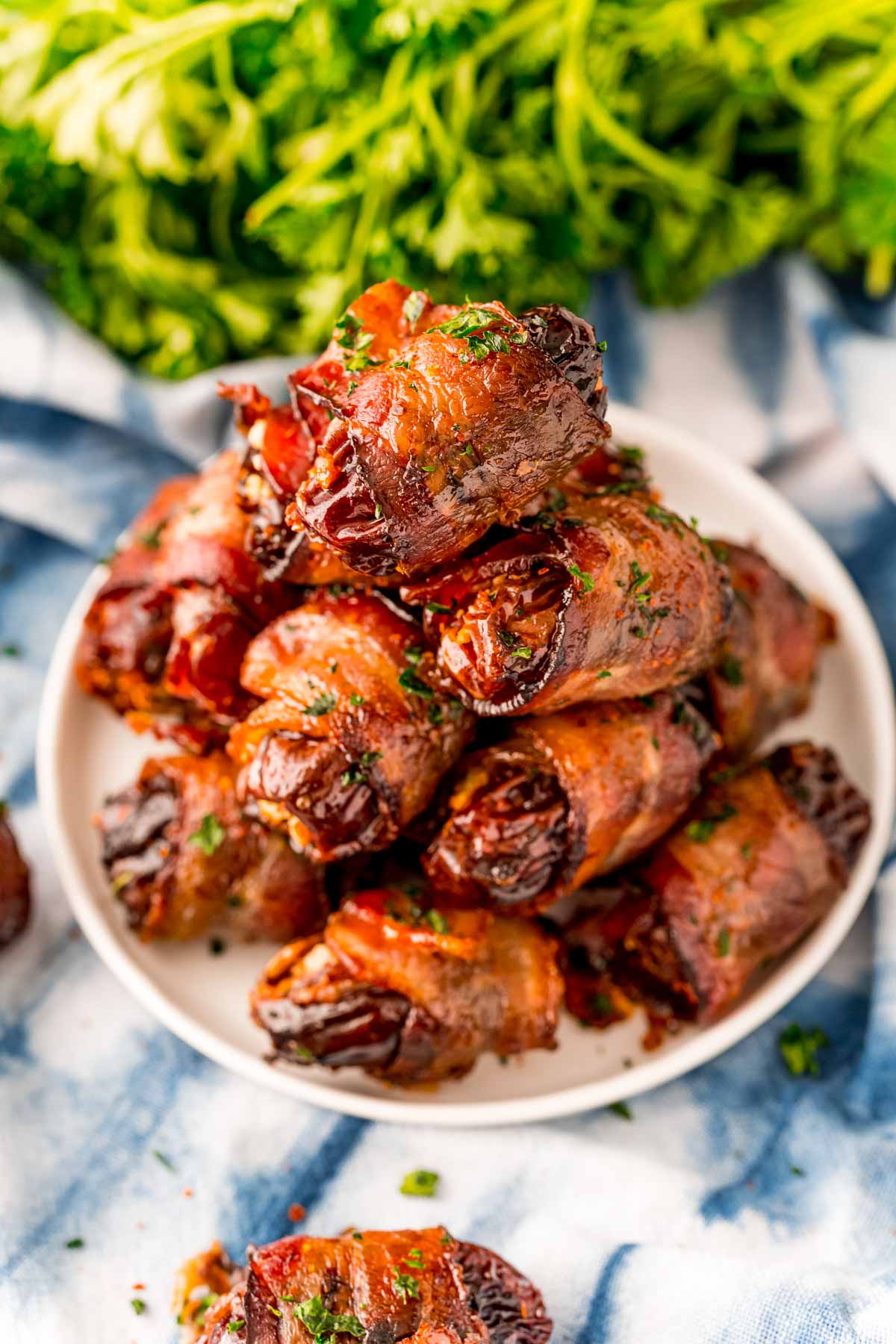 White plate with bacon wrapped dates