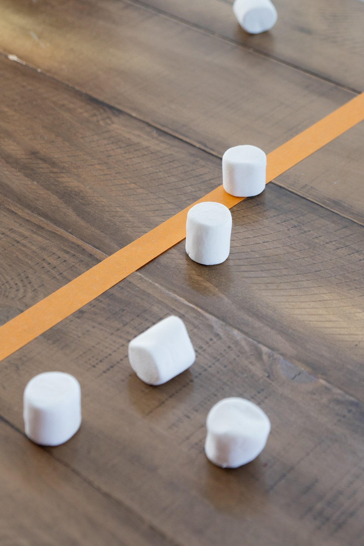 Marshmallows on a table with tape