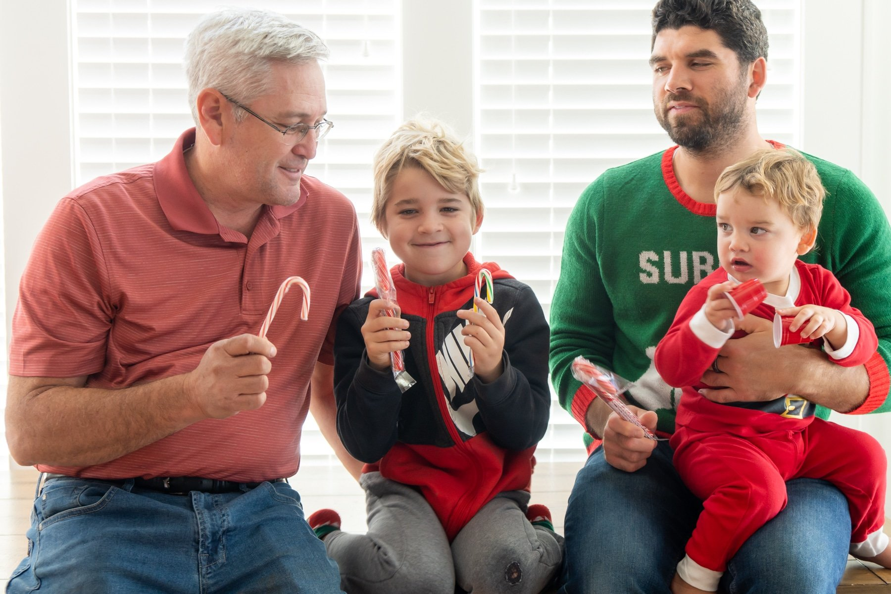 Family holding candy canes in their hand