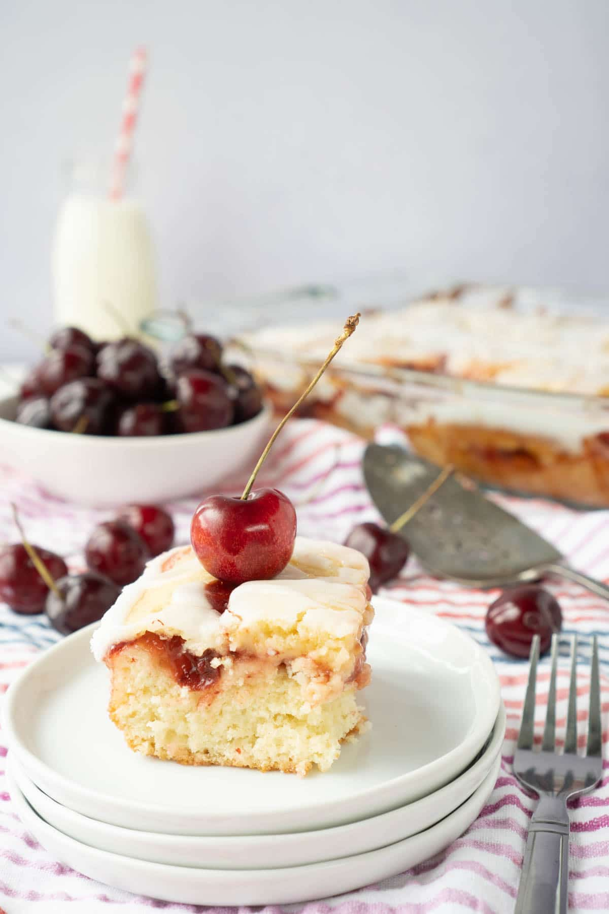 Piece of cherry cake on white plates