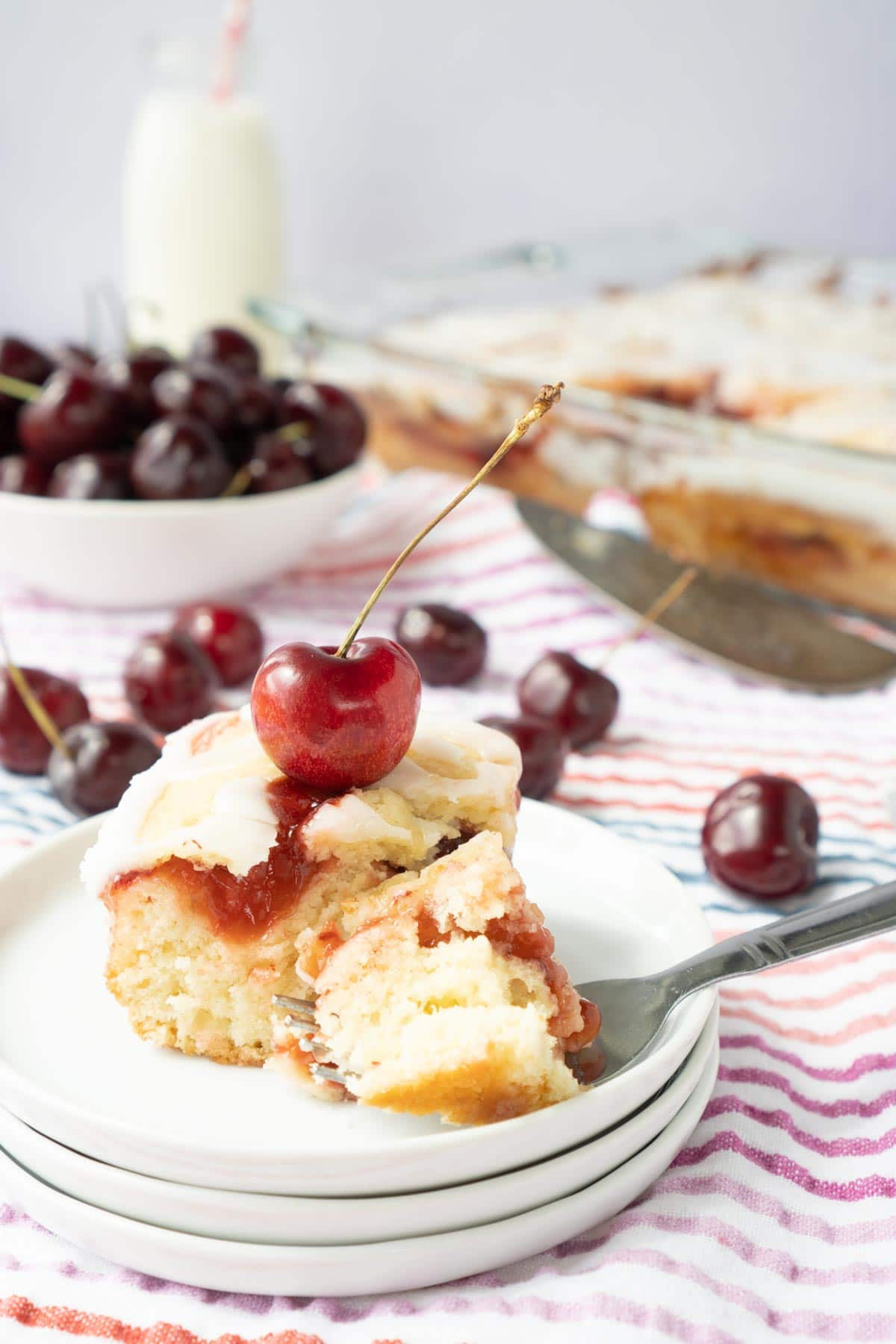 Piece of cherry cake with cherry on top