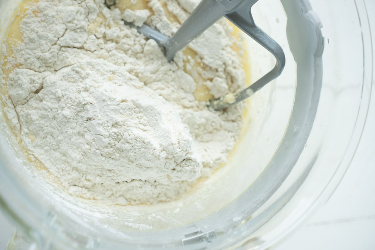 Dry ingredients added to a mixing bowl