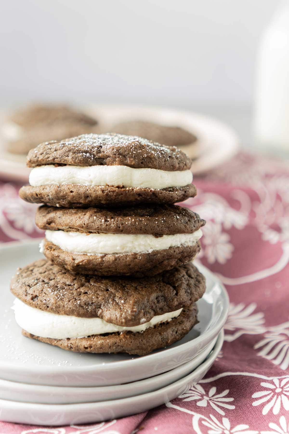 Three chocolate whoopie pies stacked on top of each other
