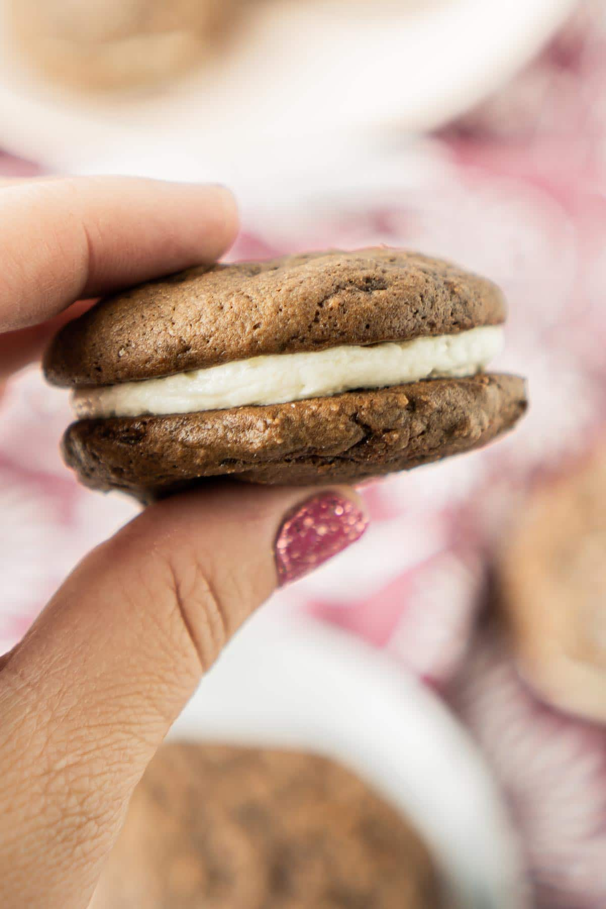 Hand holding a chocolate whoopie pie