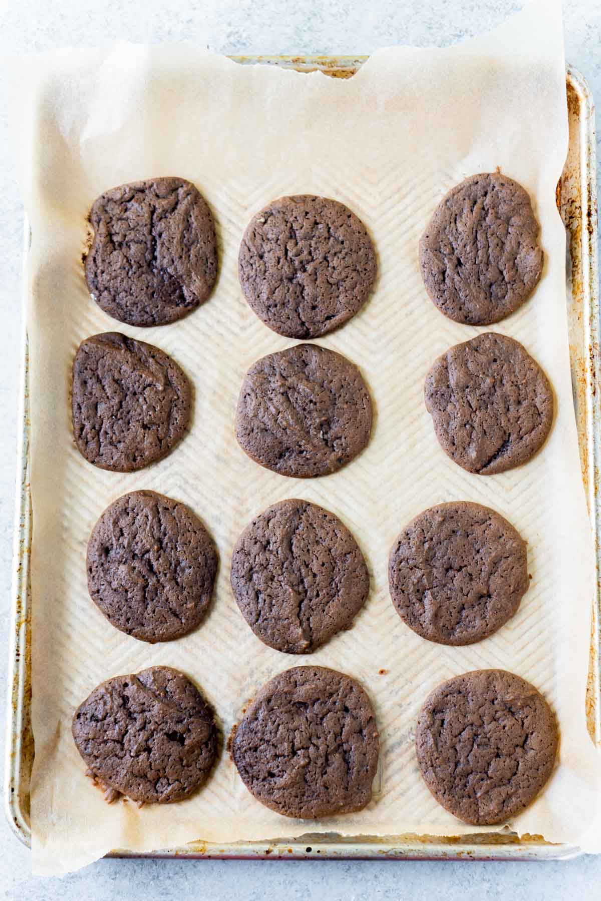 Chocolate whoopie pie cookies on a baking sheet cooling