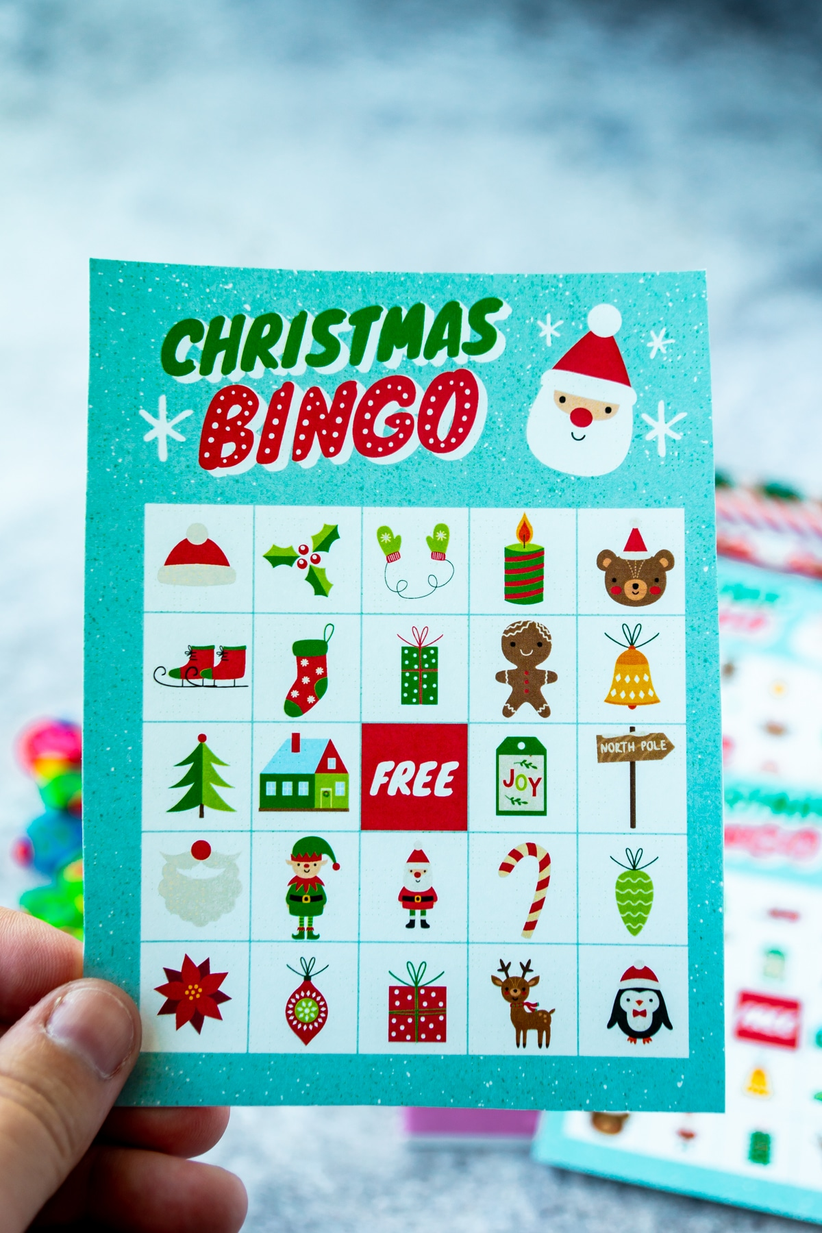 Woman's hand holding a Christmas bingo card