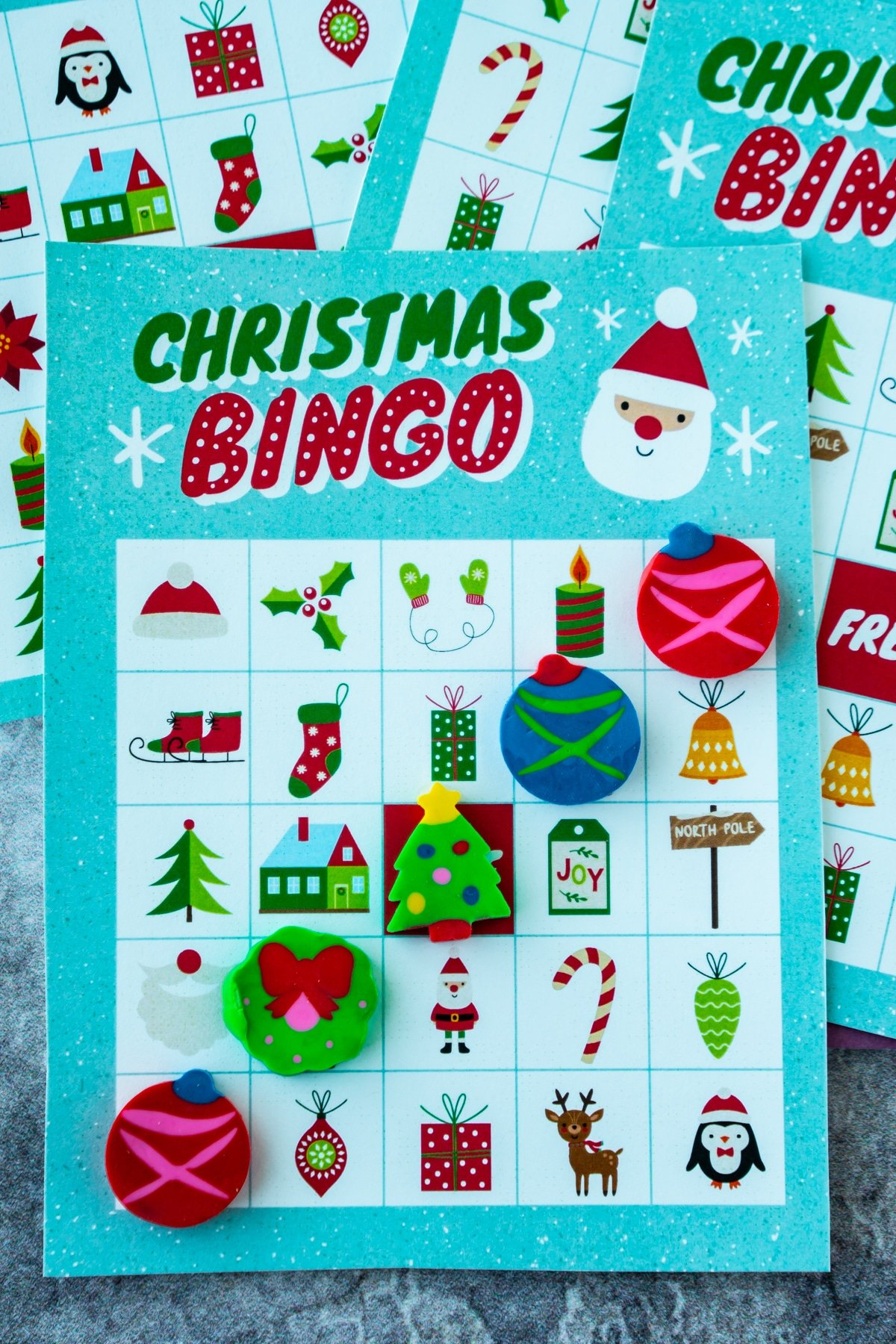 Christmas bingo card with Christmas erasers in a line