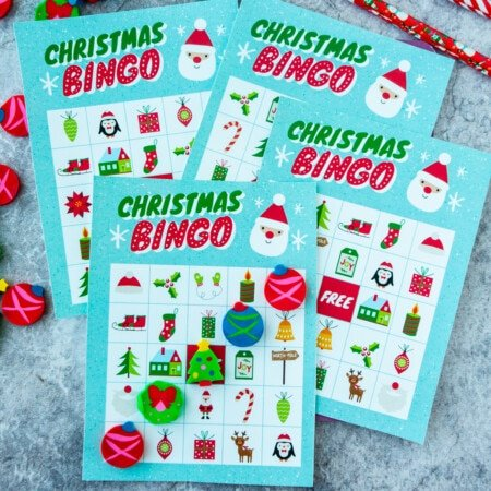 Four Christmas bingo cards stacked on top of each other