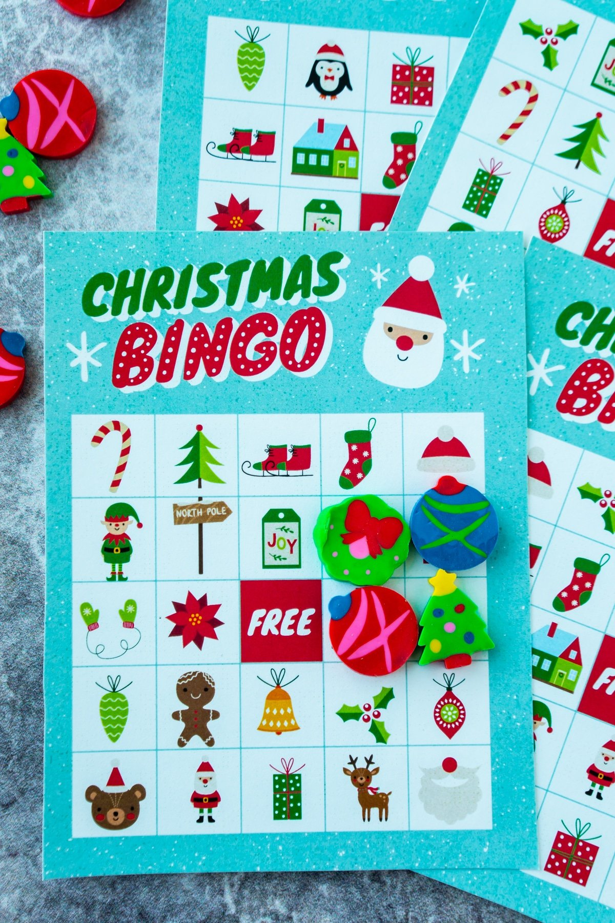 Christmas bingo cards with erasers in a square