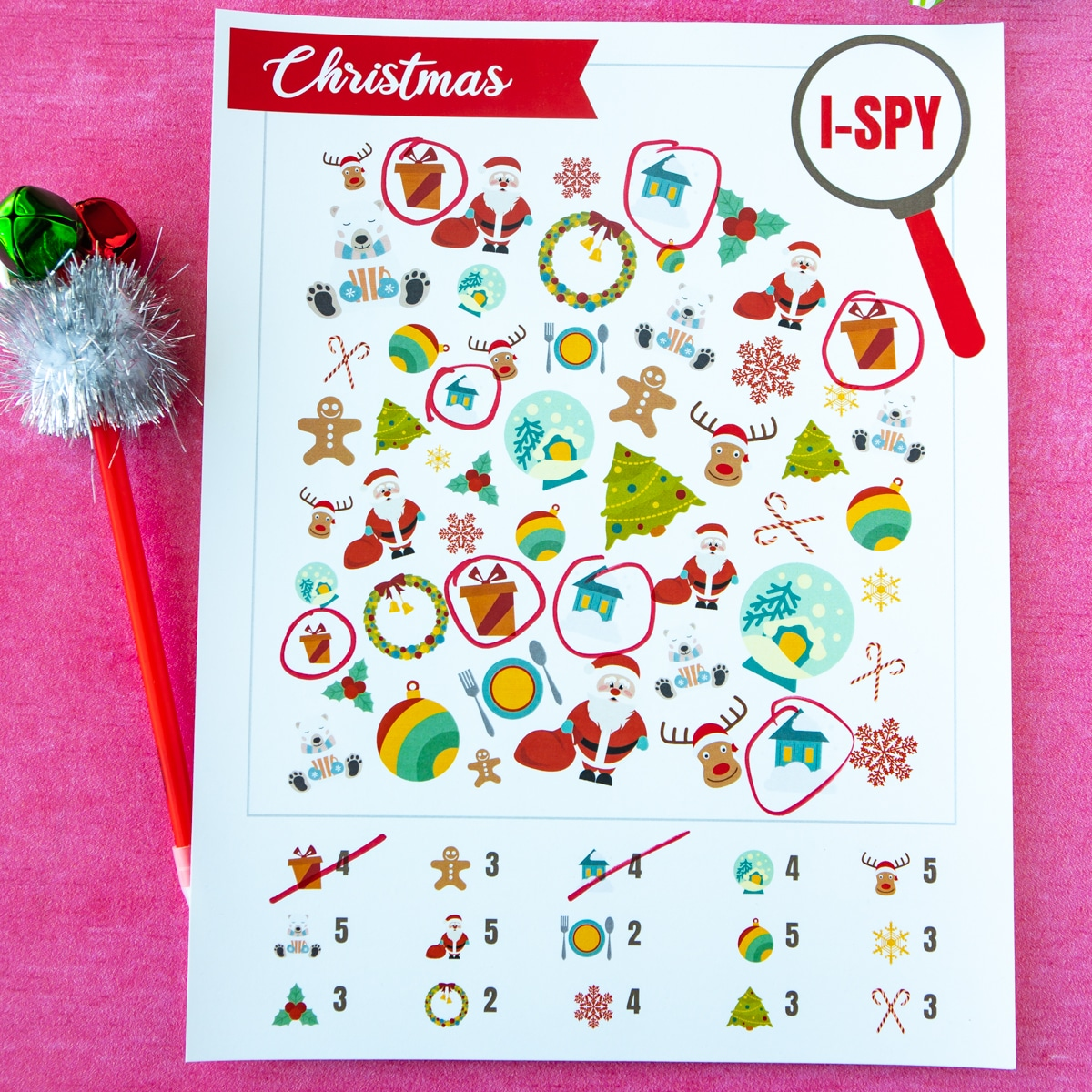 Christmas i-spy game with a pen with jingle bells