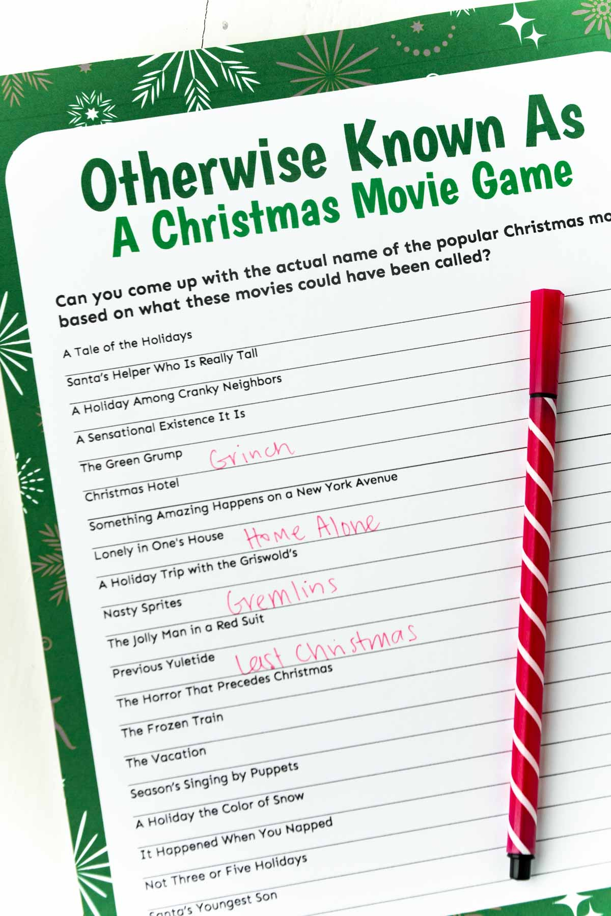 Christmas movie trivia game with a red pen on top