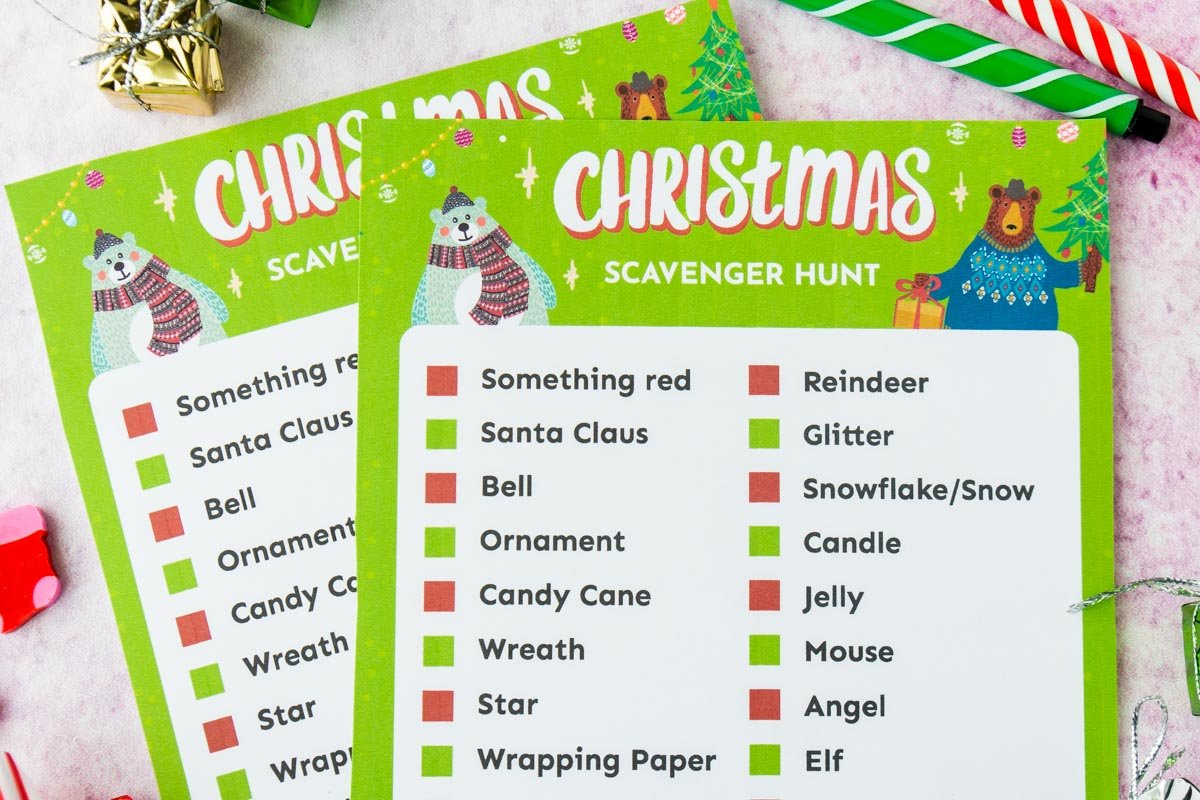 Two Christmas scavenger hunt cards on top of each other