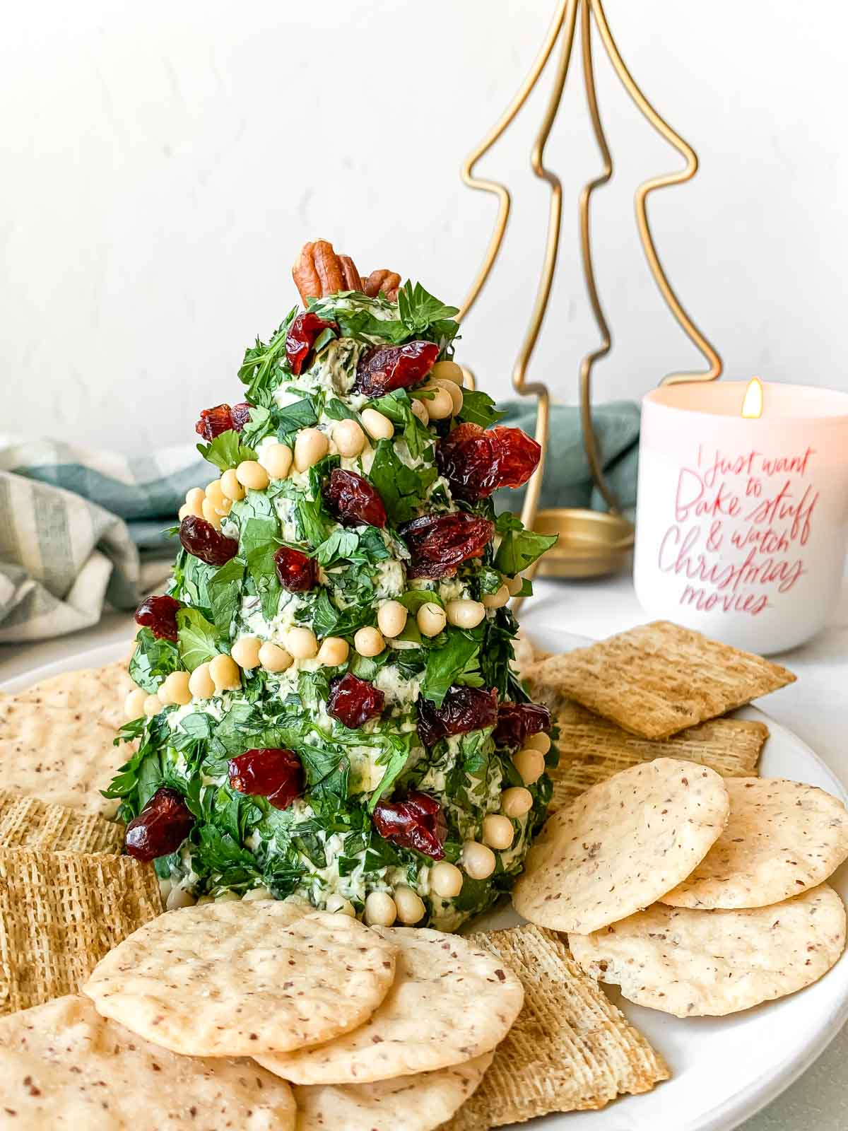Christmas tree cheese ball surrounded by crackers