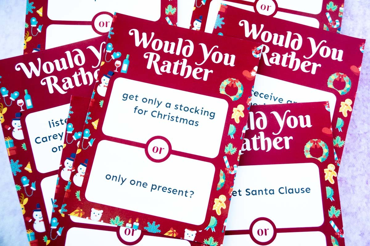 Horizontal image of a pile of Christmas would you rather questions