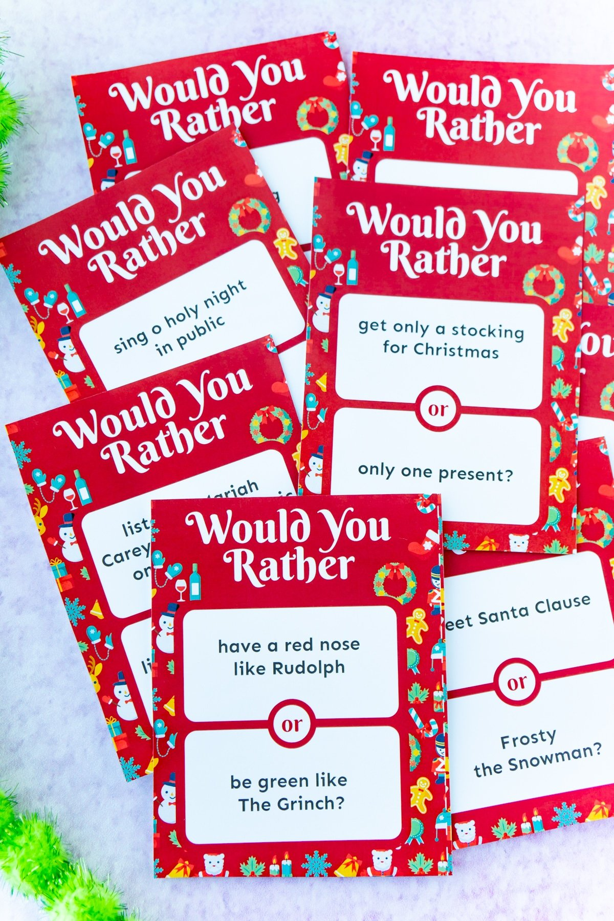 Christmas would you rather questions in a pile