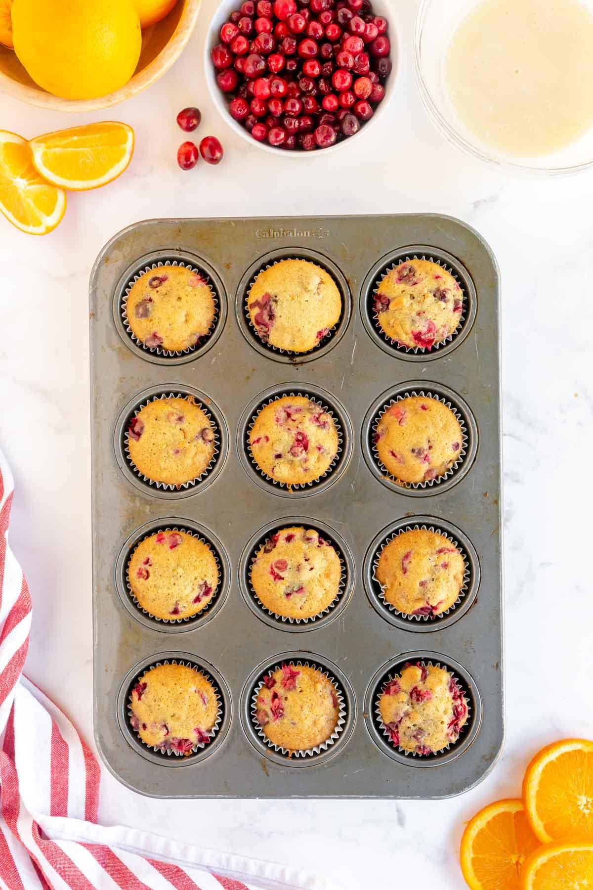 Cranberry orange muffins in muffin tins