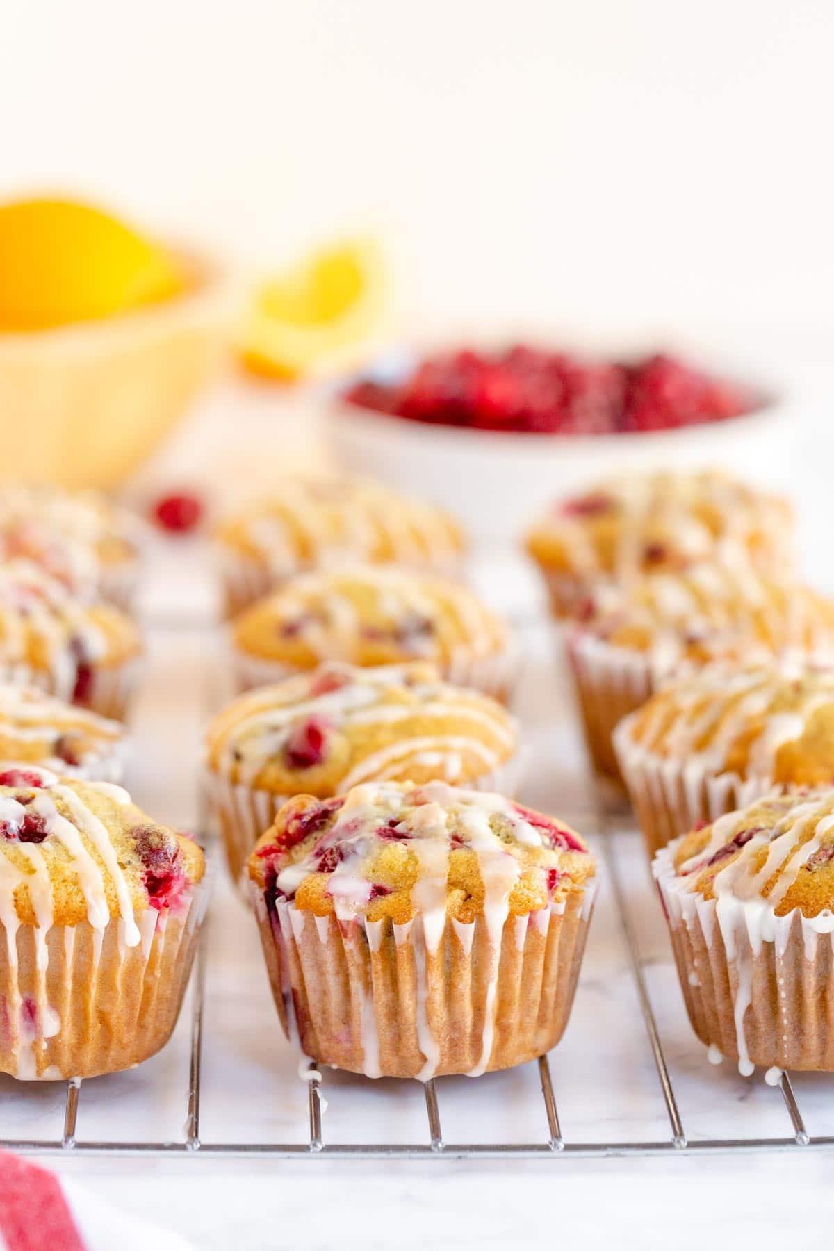 glazed cranberry orange muffins on a cooling rack