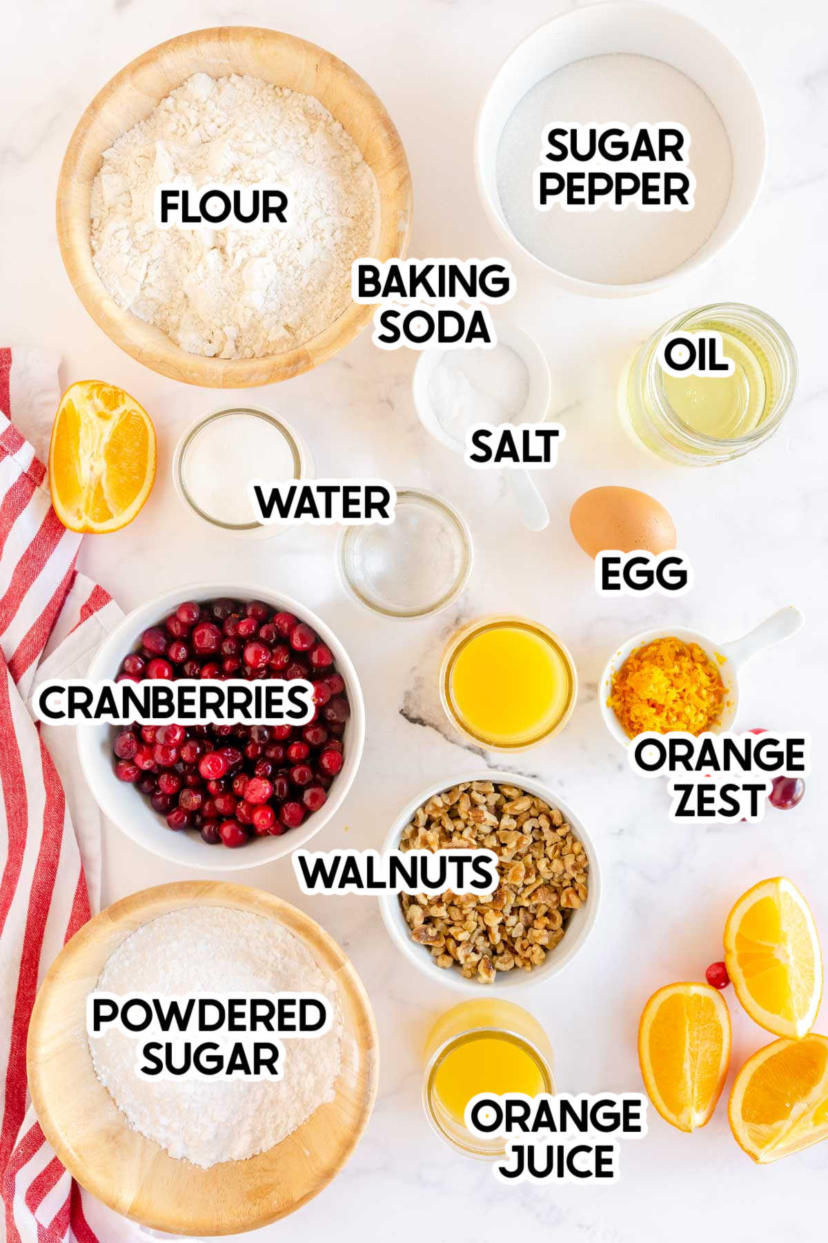 Ingredients needed for cranberry orange muffins with labels