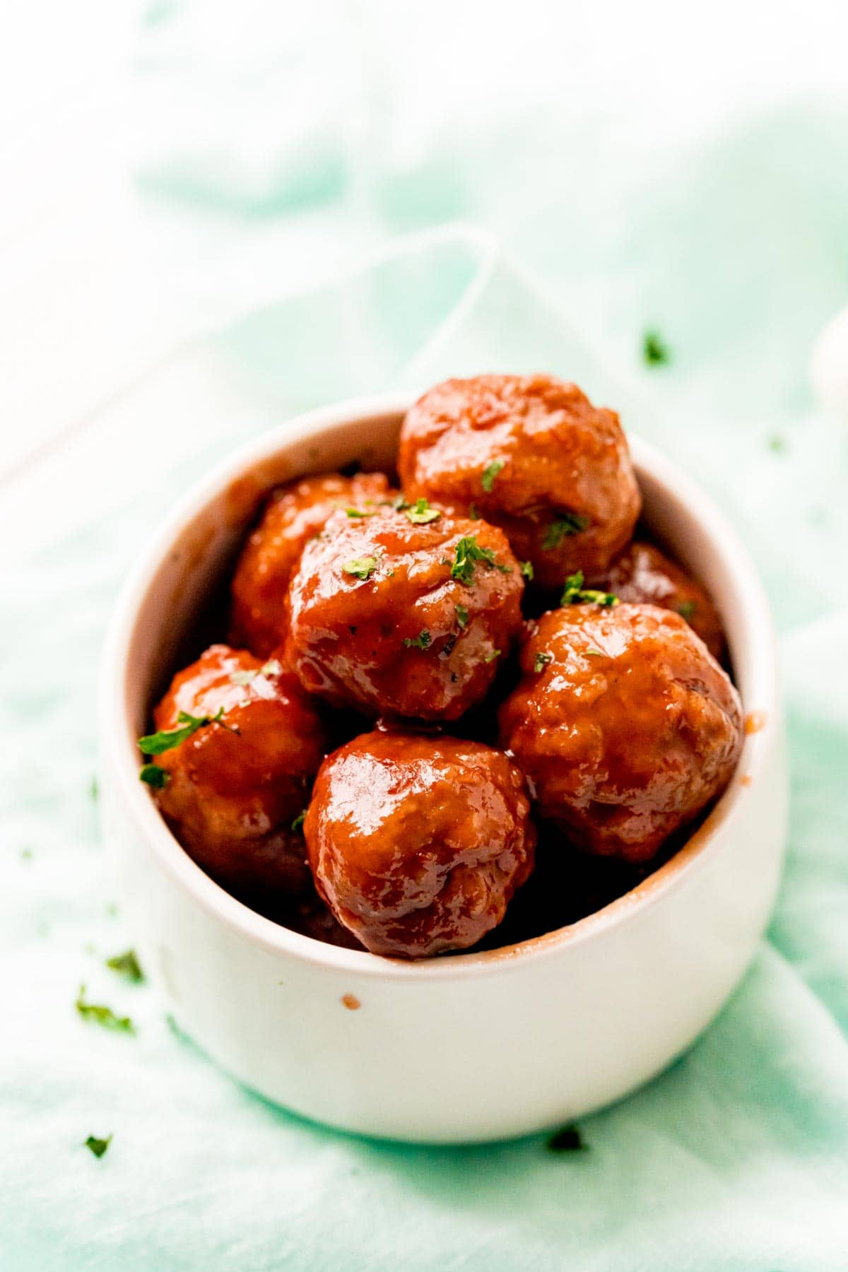 Small bowl with grape jelly meatballs