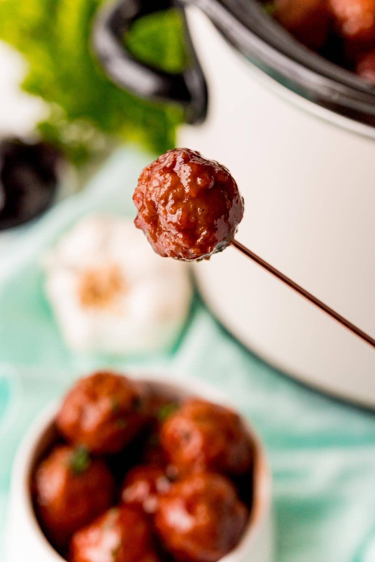 Toothpick with a crockpot grape jelly meatball