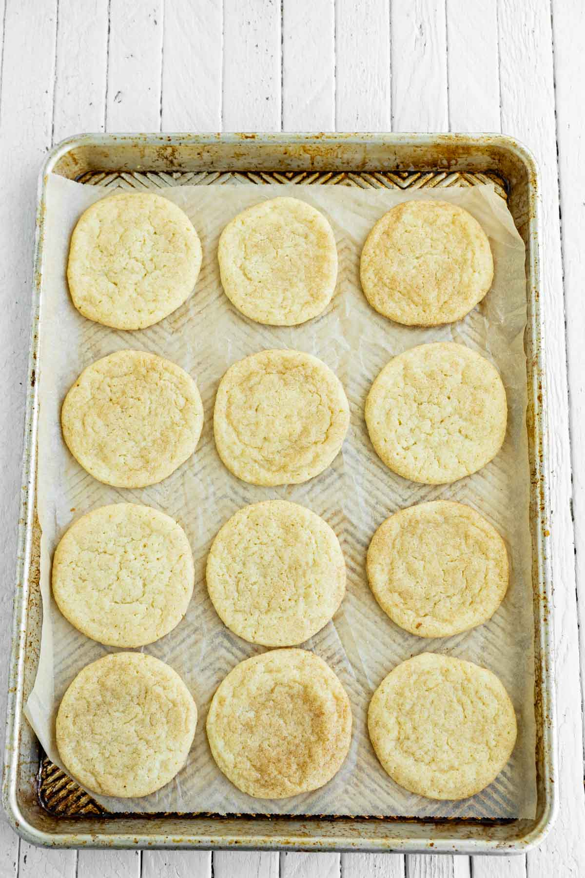 baked snickerdoodles on a cookie sheet