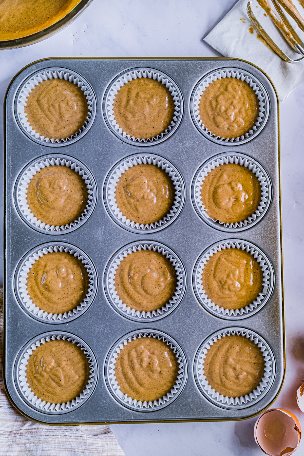 batter for gingerbread cupcakes in muffin tins