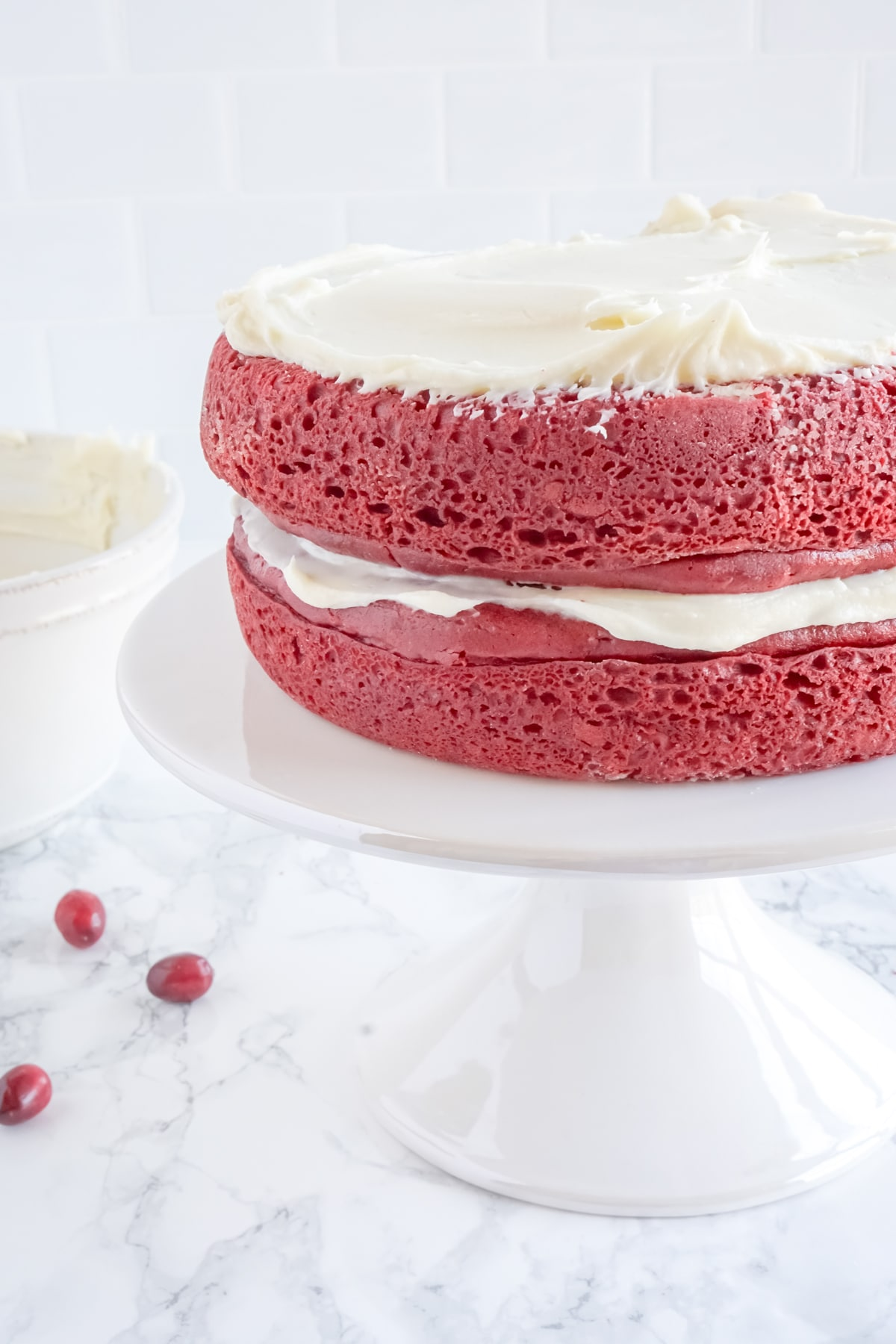 two layers of red velvet cake with cream cheese frosting