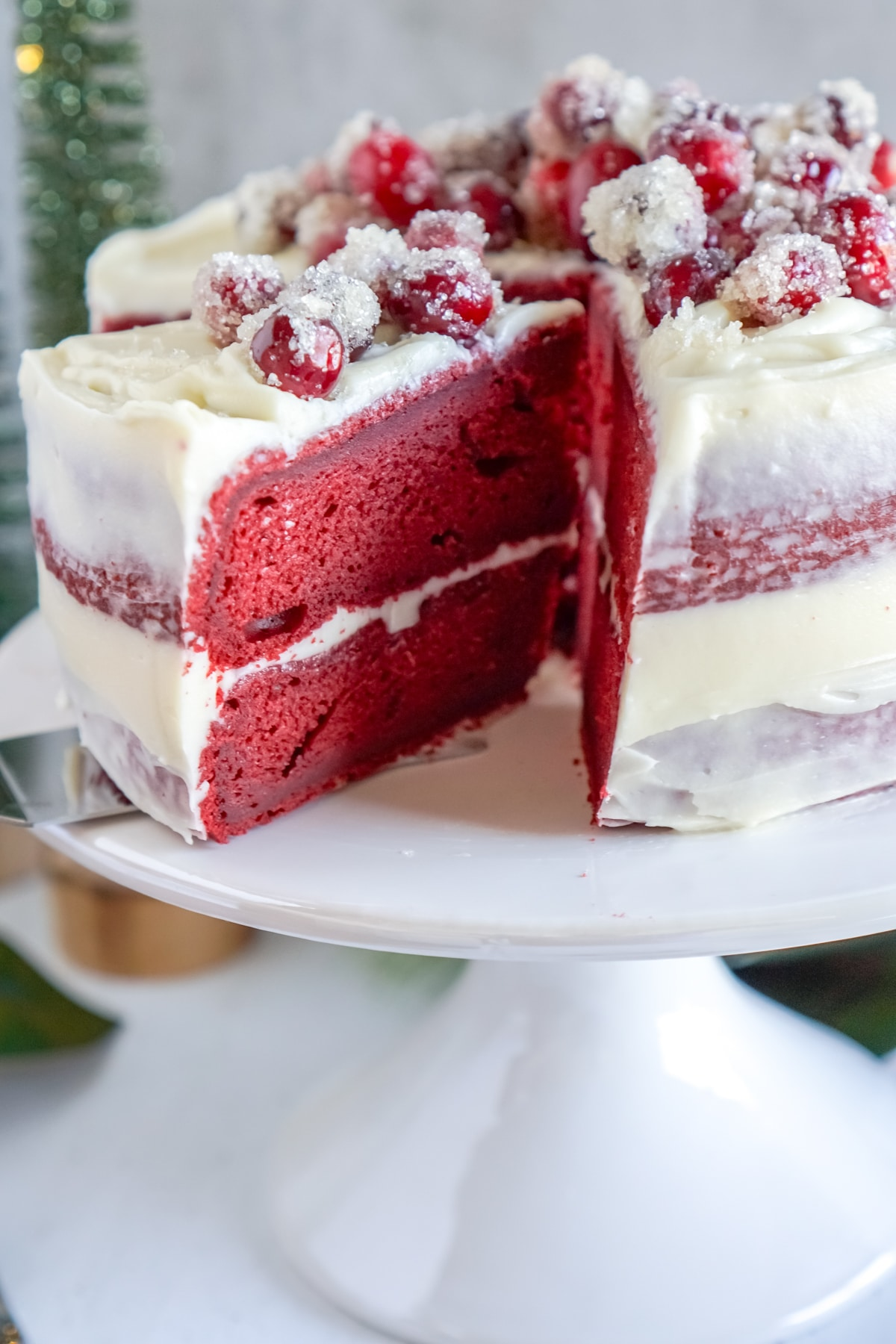 red velvet cake with a small slice cut out