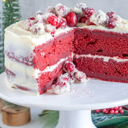 red velvet cake on a white stand
