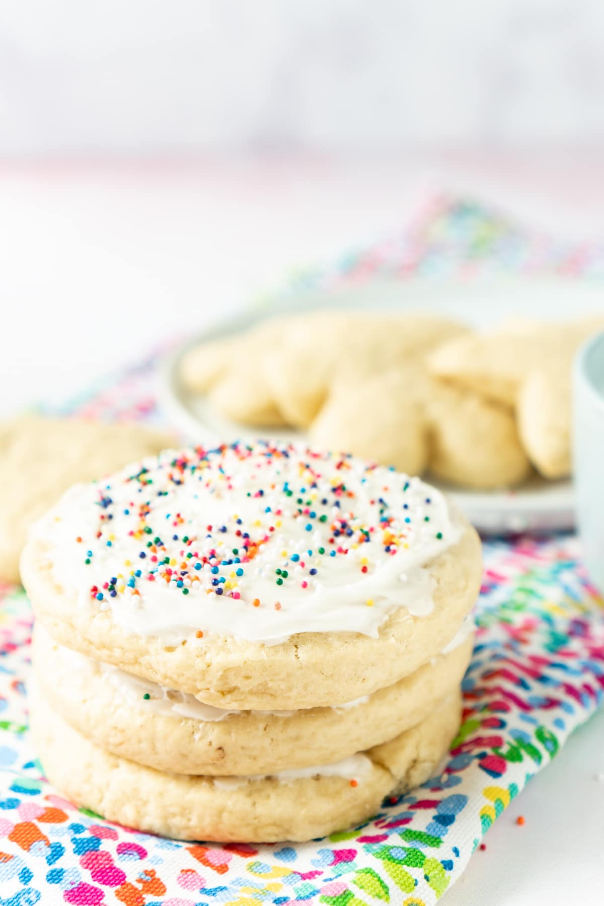 three soft sugar cookies stacked on top of each other