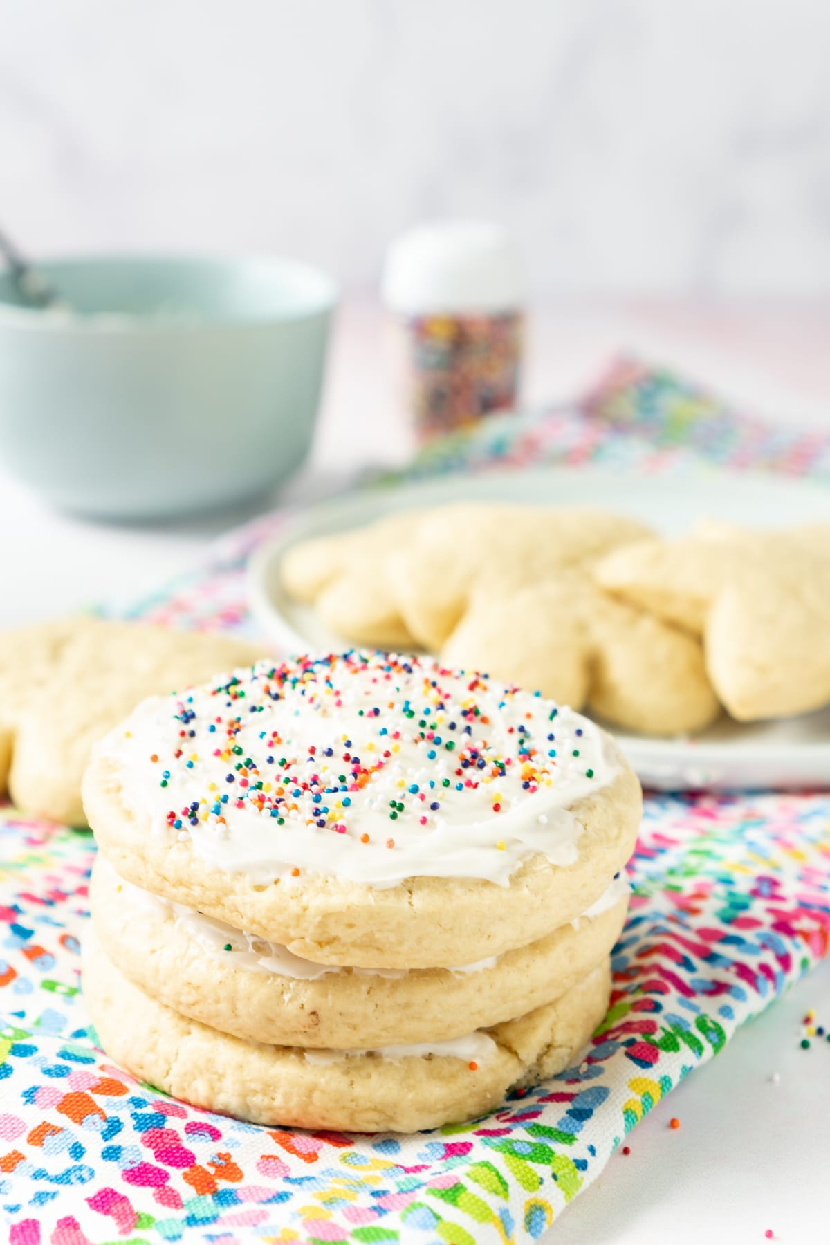 Stack of decorated cut out sugar cookies