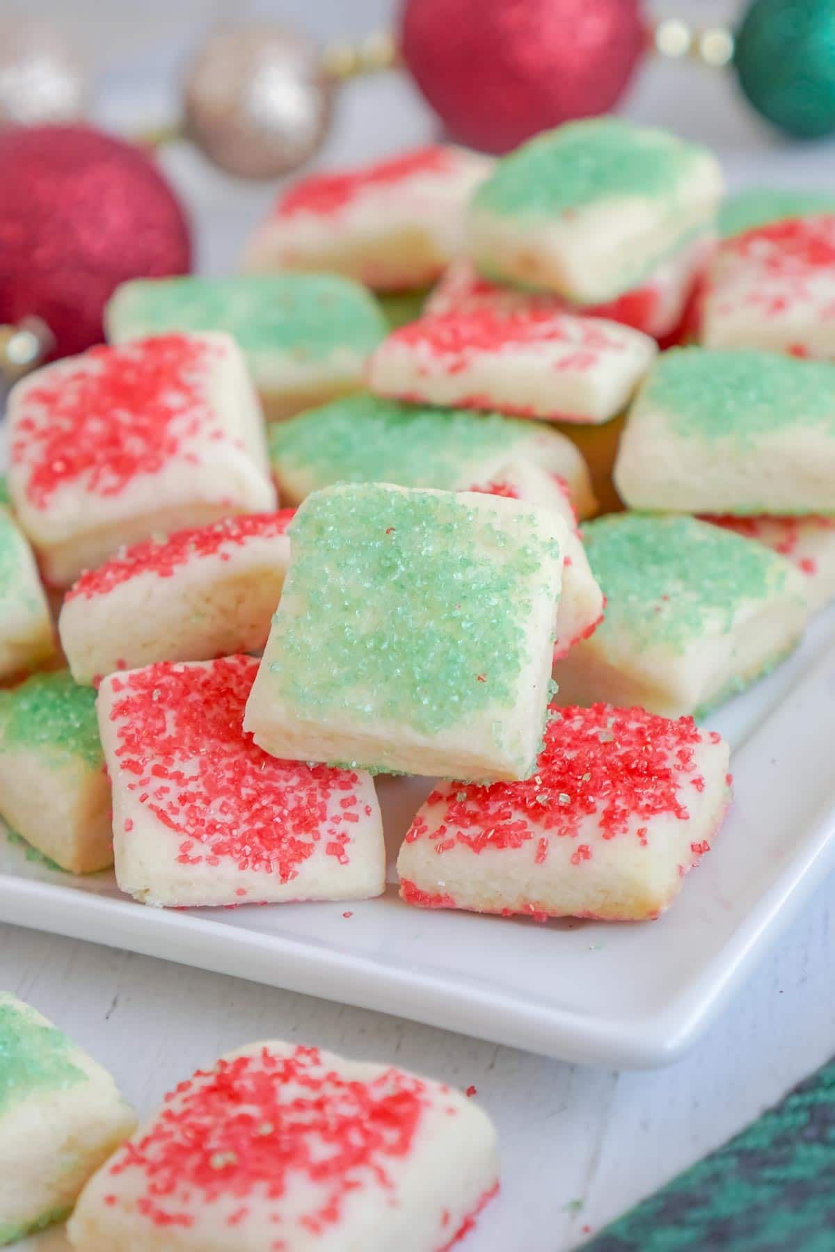 sugar cookie bites with Christmas sprinkles in a pile