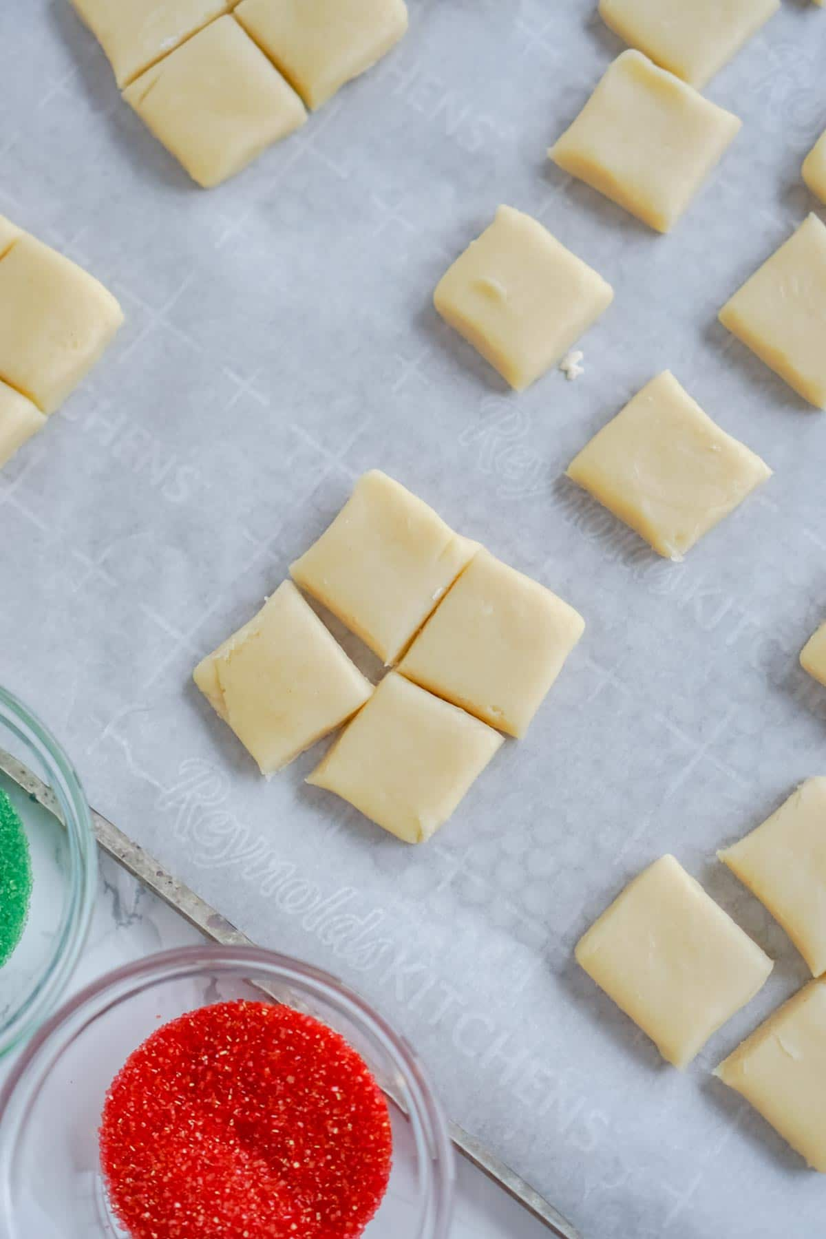 sugar cookie bites on a cookie sheet