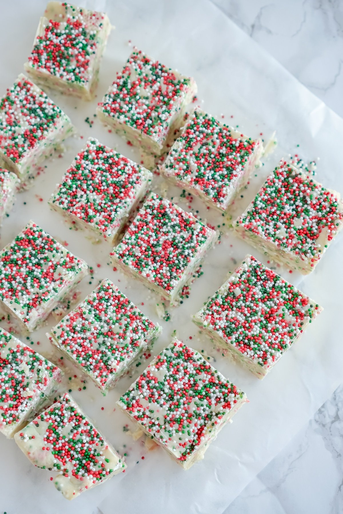 White chocolate fudge with sprinkles cut into squares