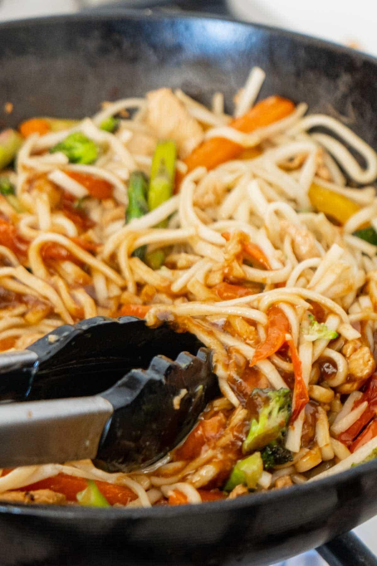 Teriyaki chicken stir fry in a wok
