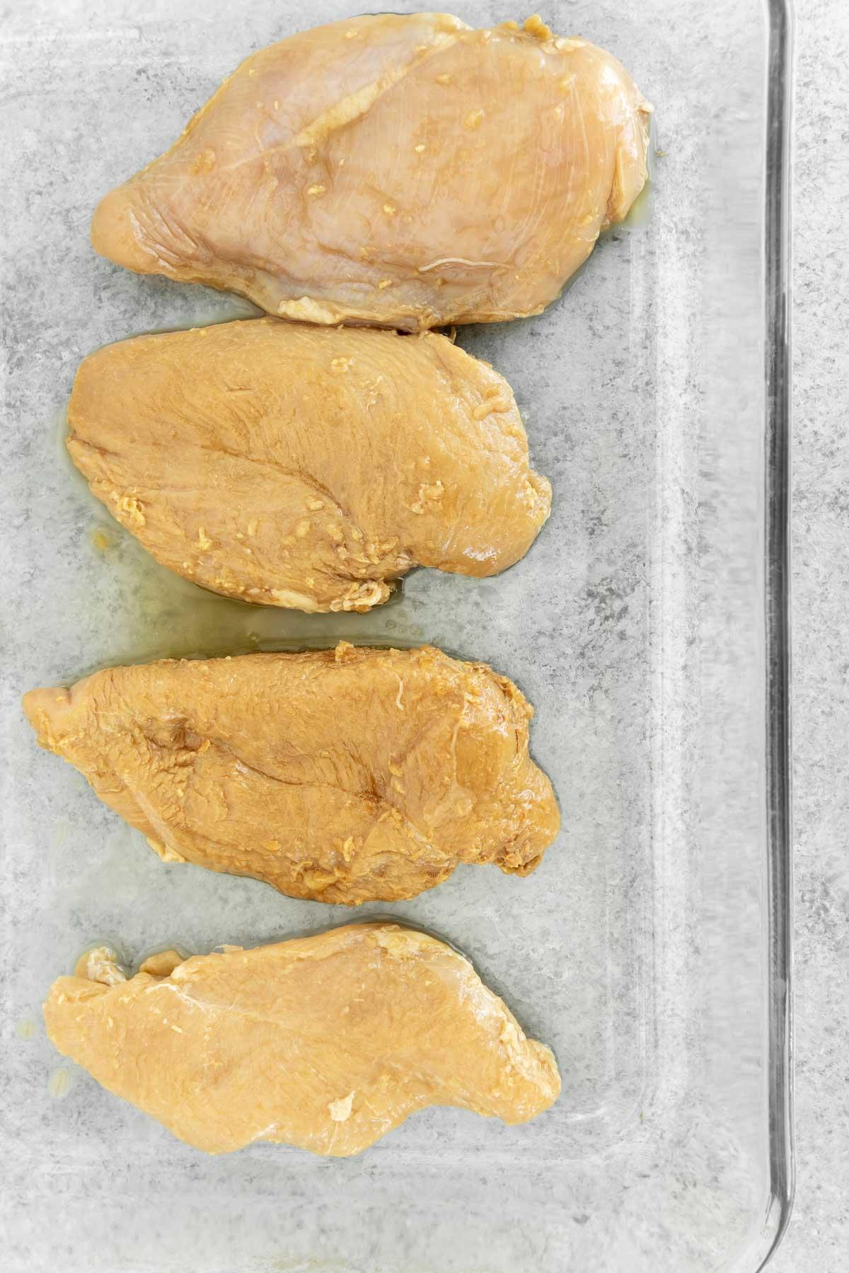 Chicken marinating for teriyaki chicken stir fry